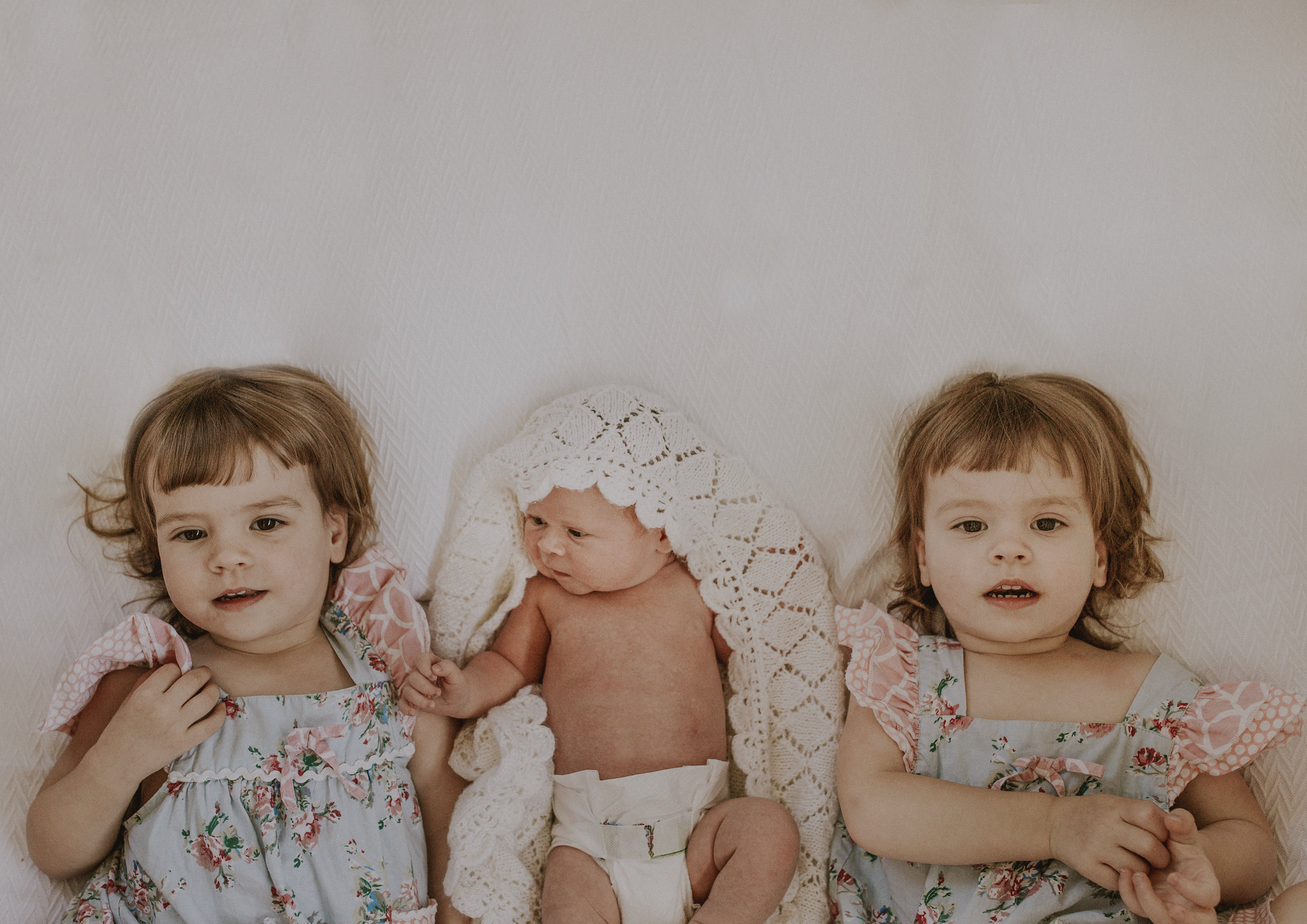 Twins girls and their newborn baby brother