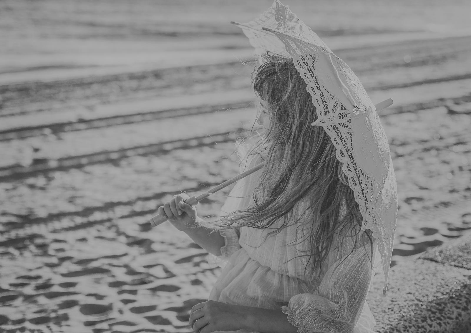 Tween model using a vintage lace umbrella