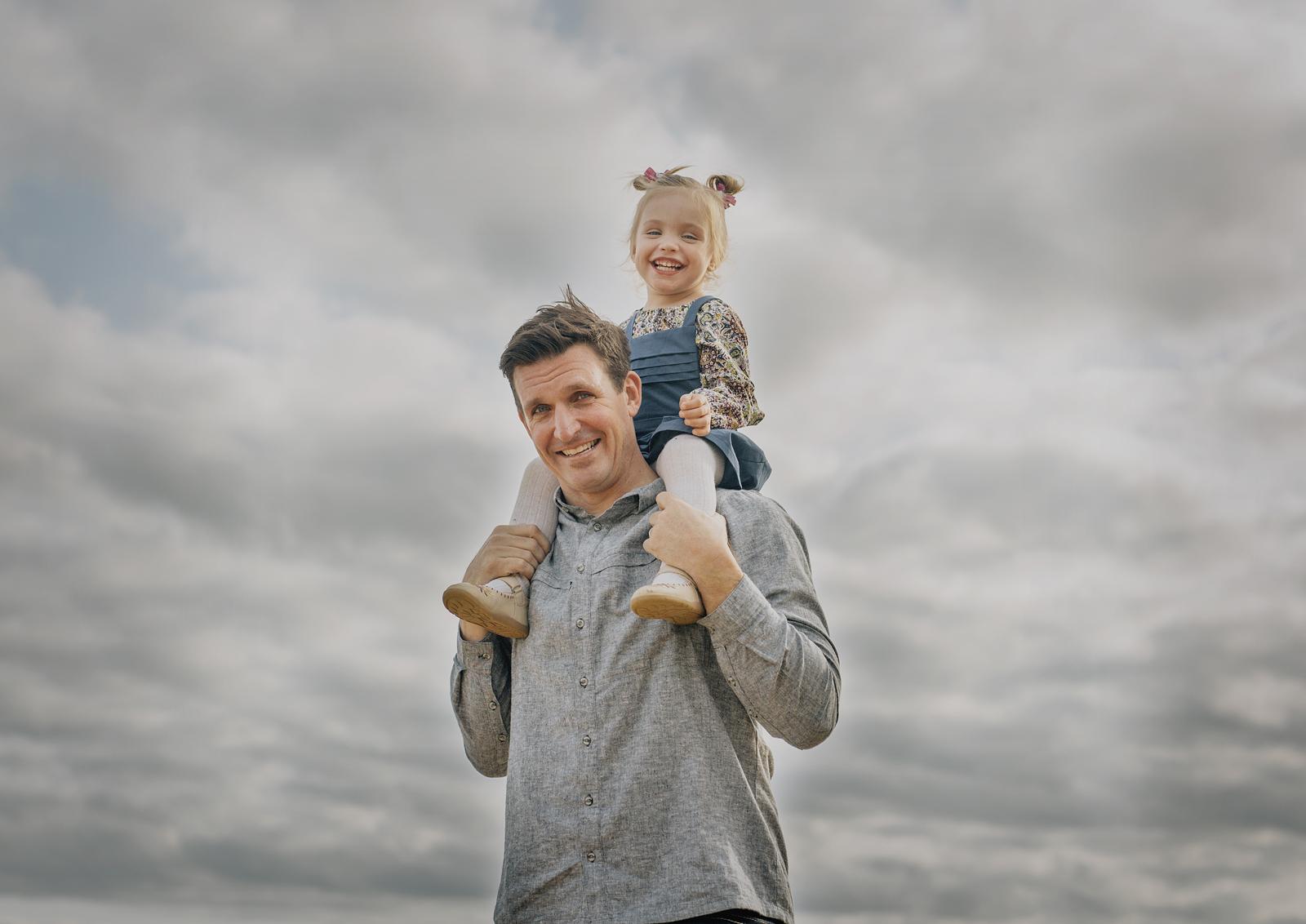 Toddler on her Dad's shoulders