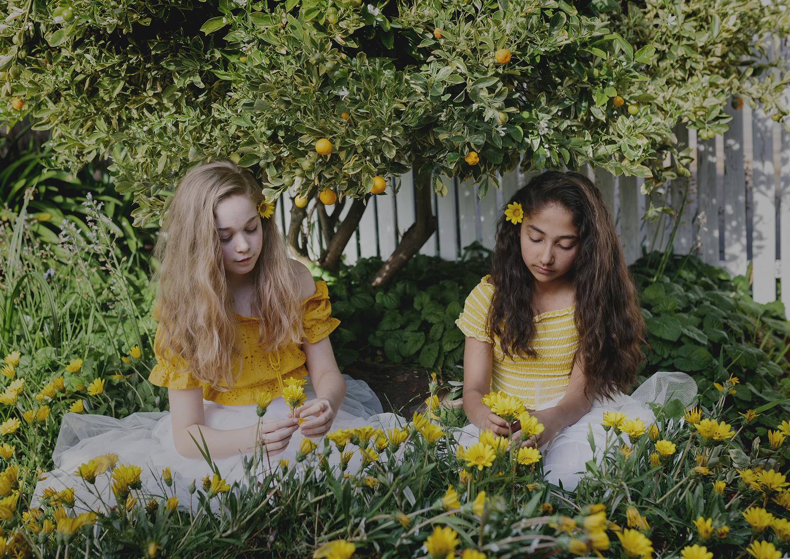 Best friends making daisy chains