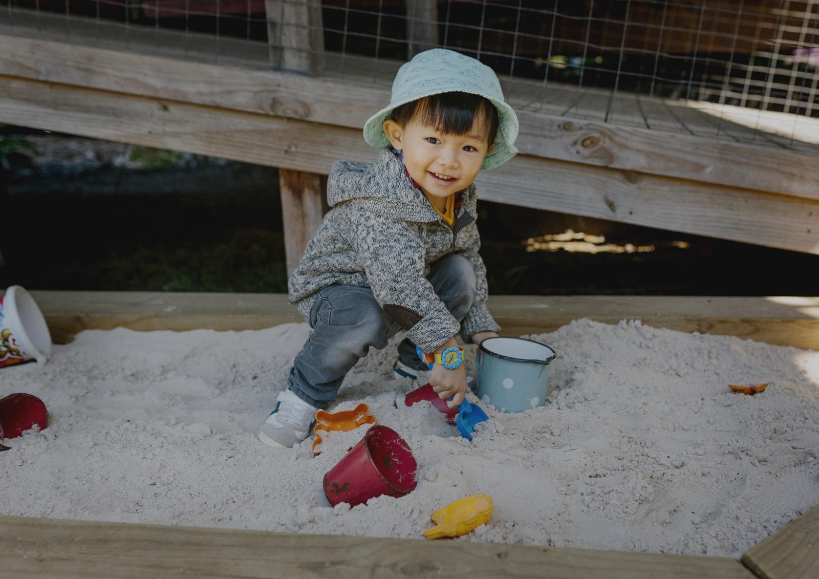 Toddler having fun in the sandpit