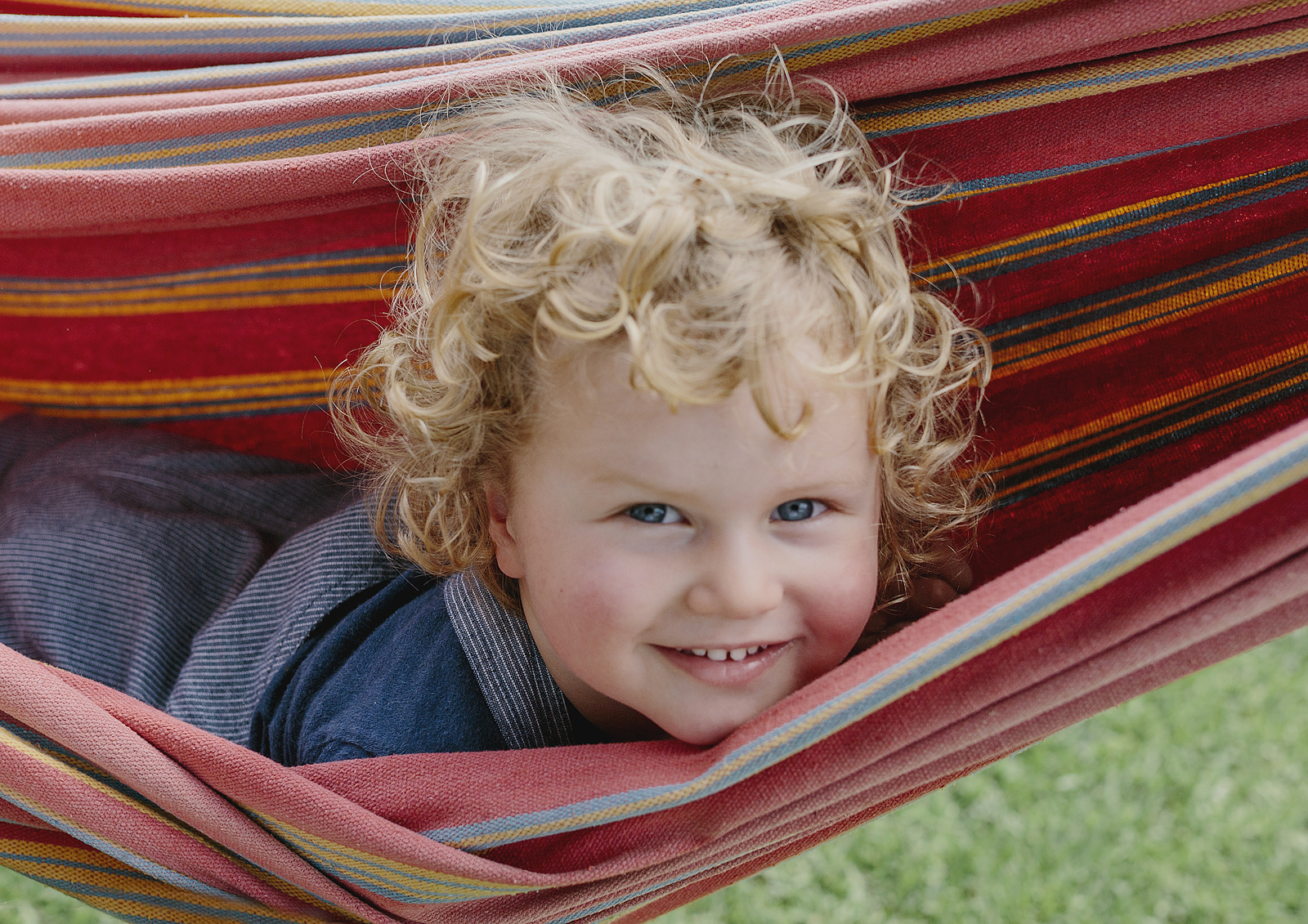 Toddler playing in the hammock