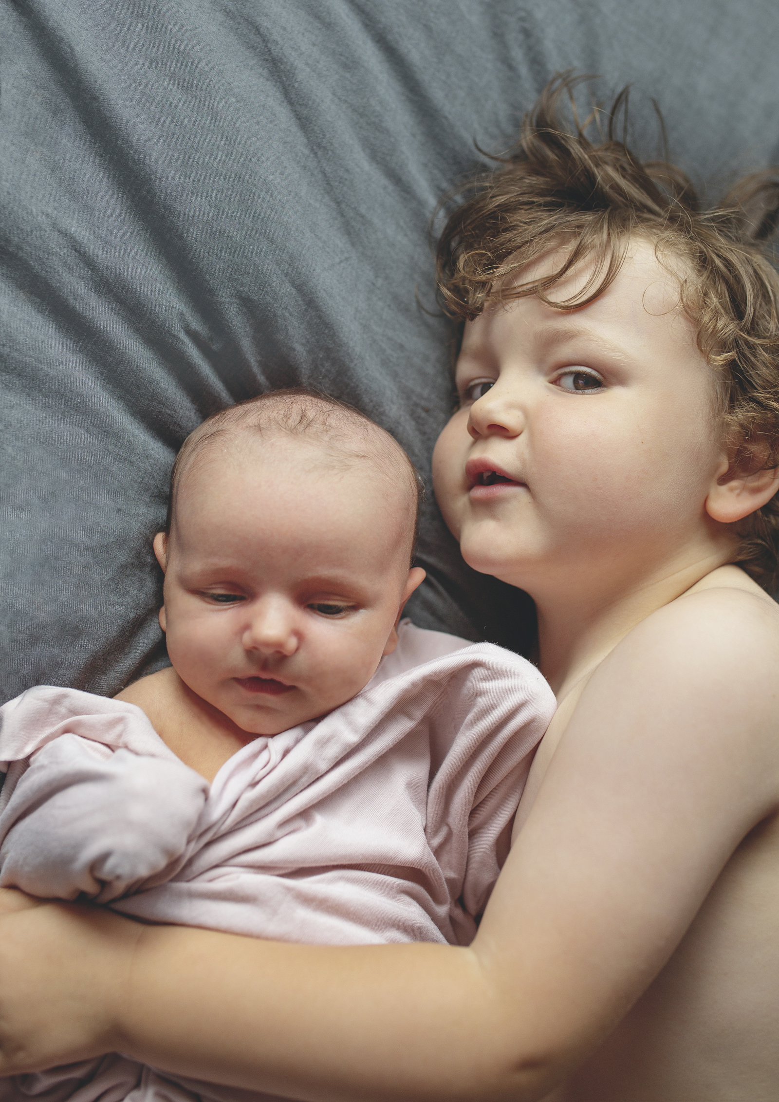 Big brother loves his baby sister