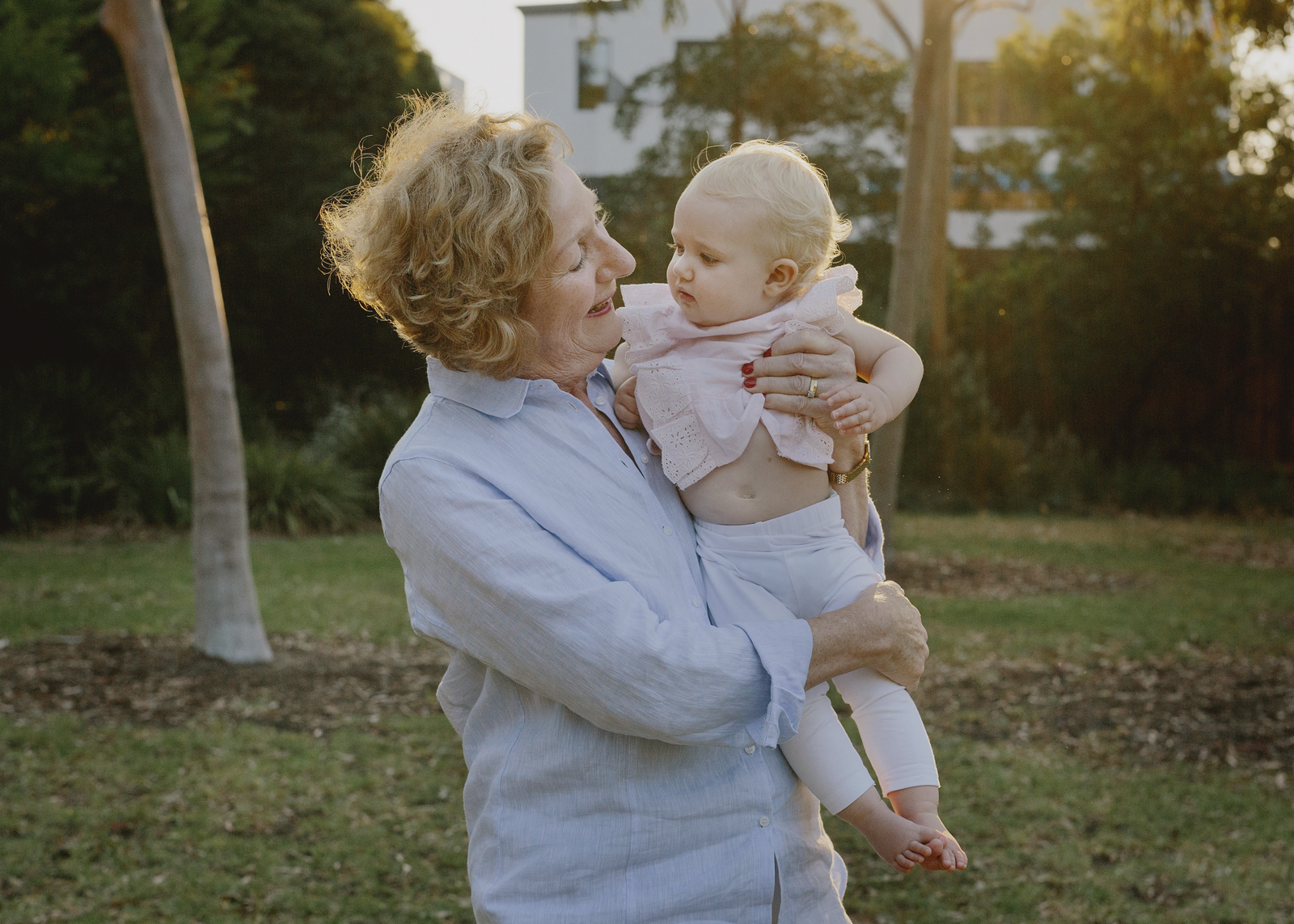 Nana cuddling her baby grandchild