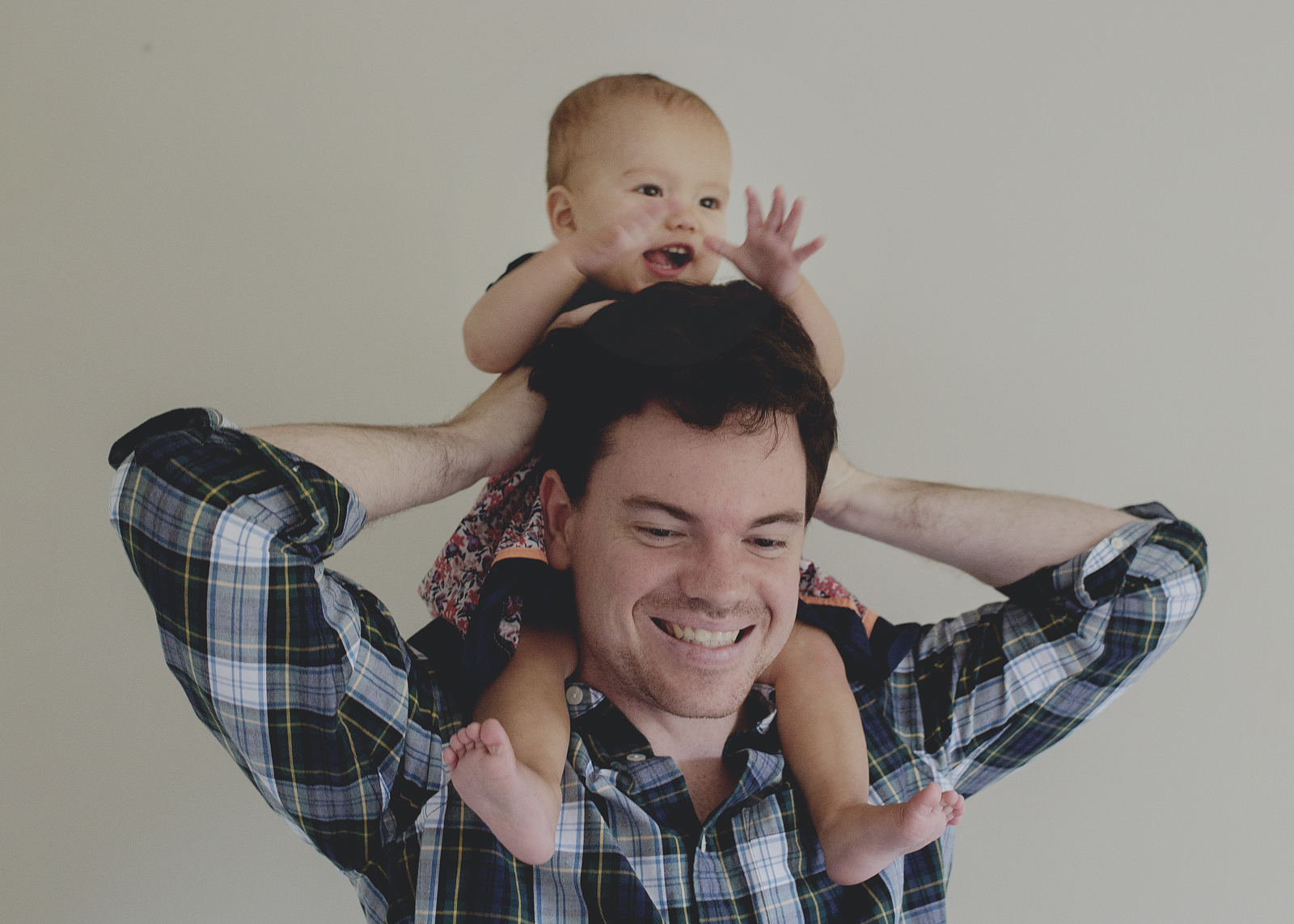 Baby girl on top of Dad's shoulders