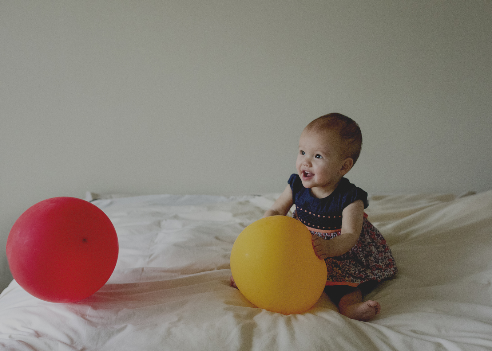Baby girl play time with balloons