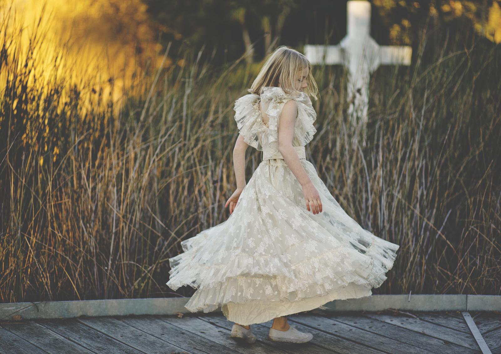 Tween girl dancing in her vintage dress
