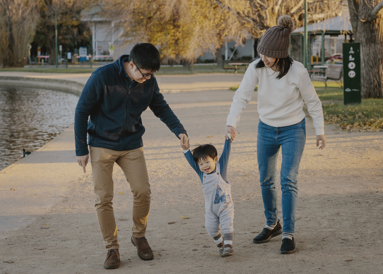 Family walking along Albert Park Lake