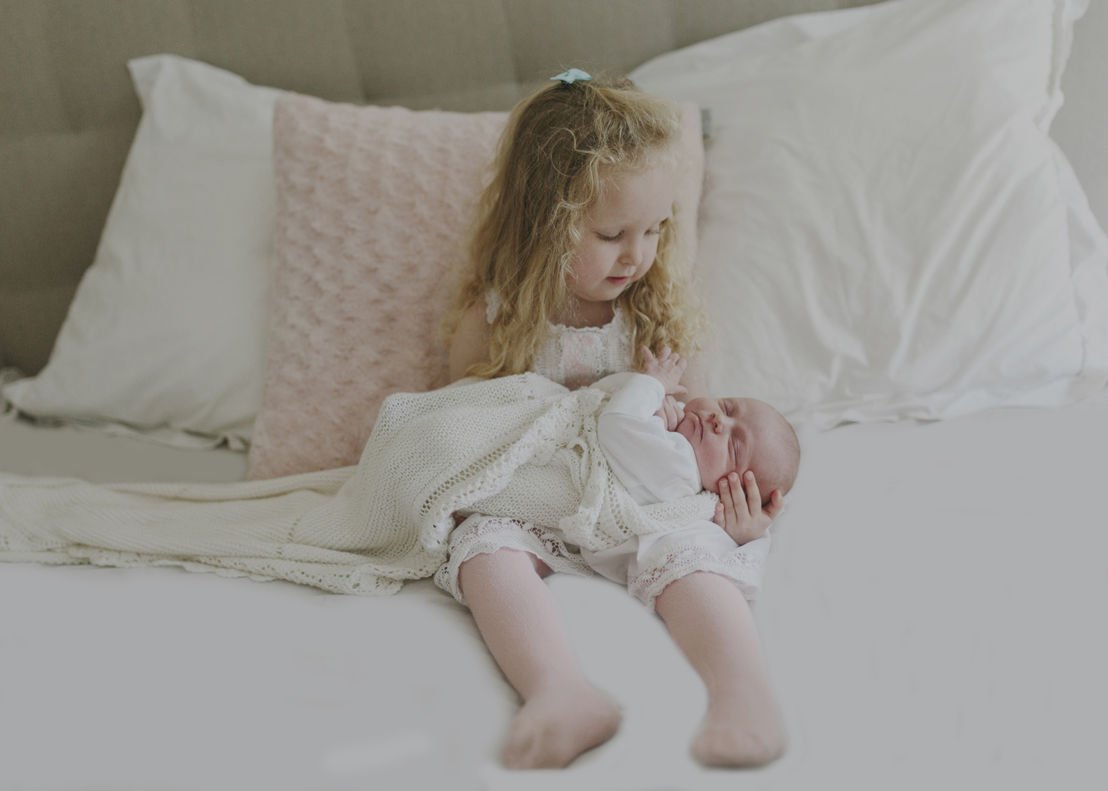 Big sister loves her newborn baby sister