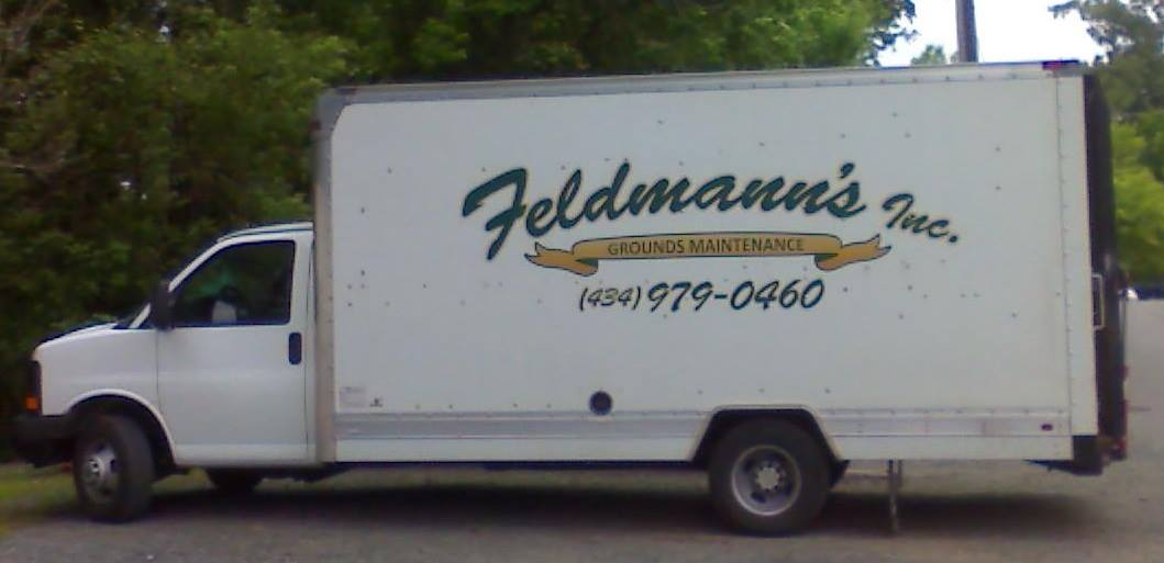 Image of Feldmann's Inc. work truck located in Charlottesville along with Morris Lawn Care and Services.