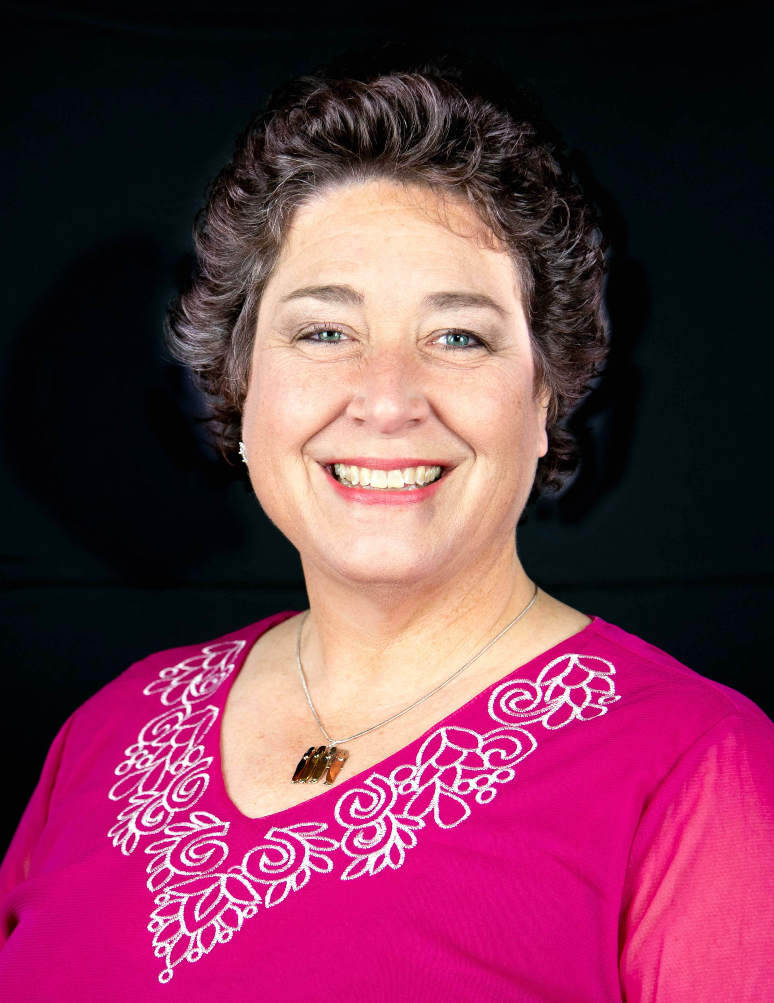 Leslie Schultz, Bass    Leslie joined the Cincinnati Sound Sweet Adelines chorus in 2018 as a tribute to her grandmother, who sang with the Royal Palm Chapter chorus and  Coco-Notes quartet in West Palm Beach, Florida during the 1950s. The Royal Palm chapter chorus and Coco-Notes quartet became Southeastern Regional Champions in 1956. Music has always been a part of Leslie's life thru singing in church/school choirs and the high school show choir (where she won the Choral award during her senior year), playing piano for over 12 years and studying dance for over 15 years. She has been married to one of her biggest fans for over 20 years and has three grown sons and two daughter-in-laws. Recently, Leslie became a new grandmother with the birth of her first grandson. Leslie currently works in the Alumni Relations Department at Northern Kentucky University (NKU), volunteers for church and community events, enjoys traveling or a vigorous walk outside and attends NKU part-time to finish her degree in Business Administration.