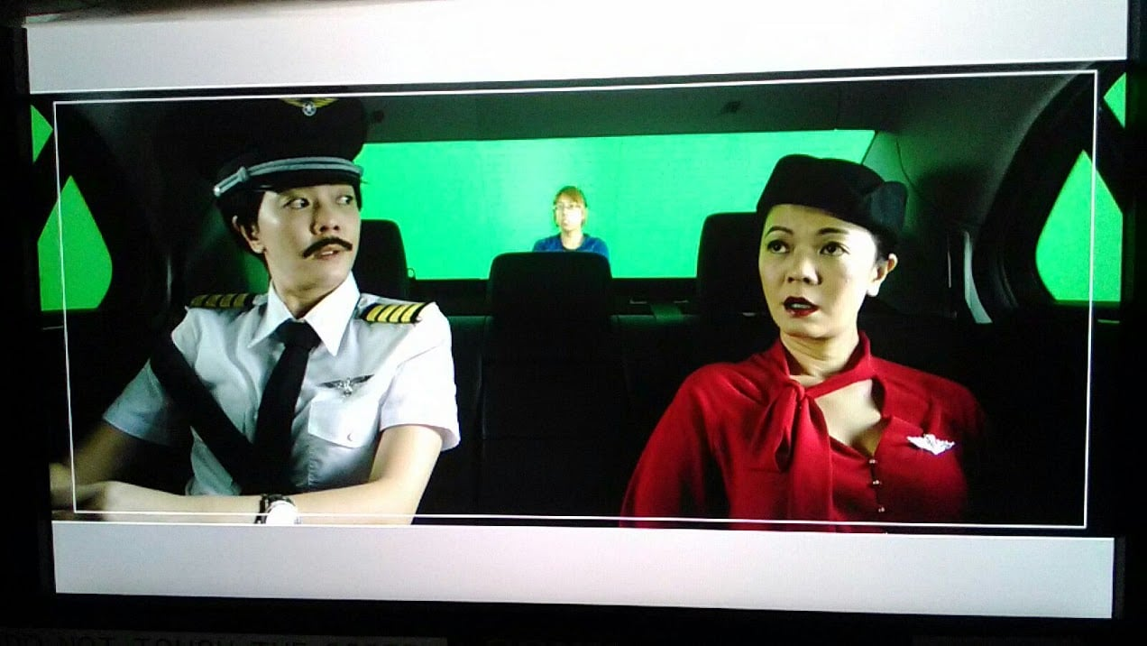 Michelle Chong as the air stewardess and pilot in OCBC OneTouch TVC