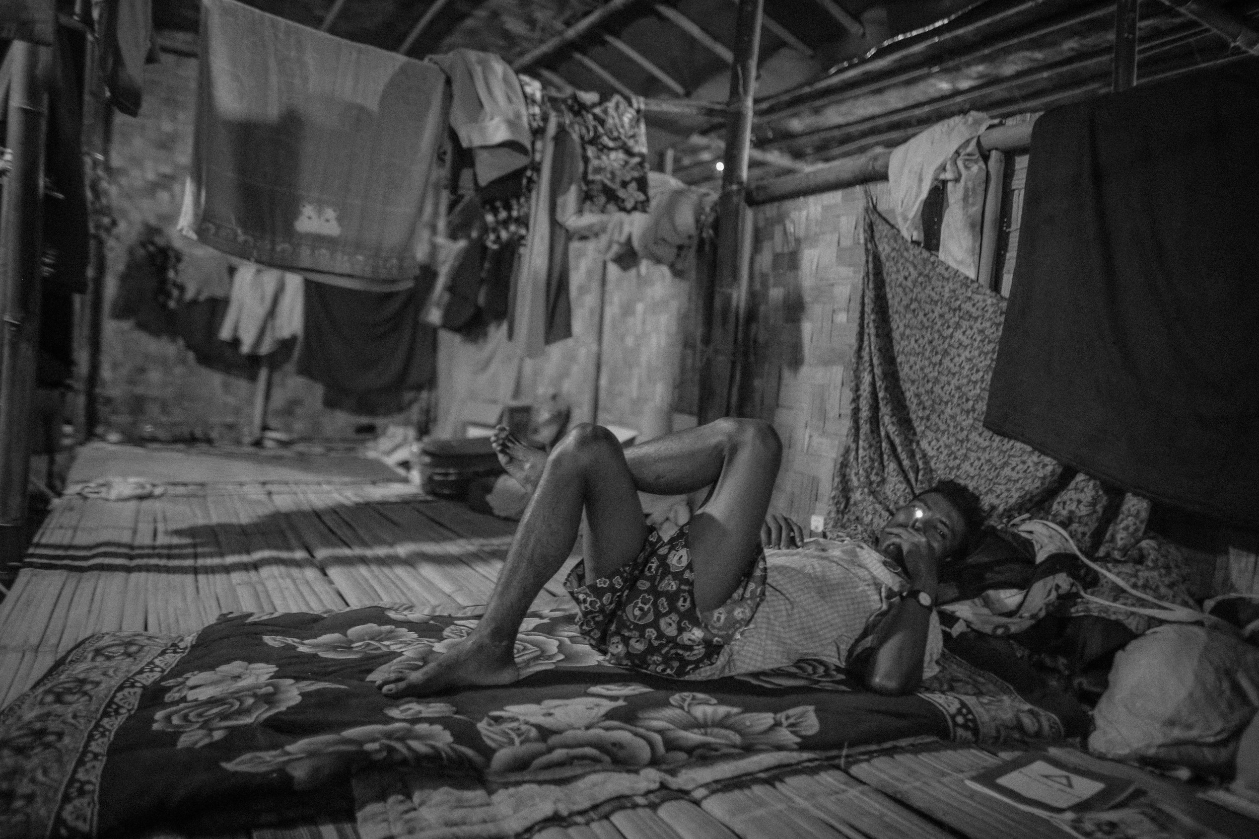 Tu Ring, 42, a former black opium addict (also called black heroin), smokes a cheroot in his dormitory at the Aung Mintha rehab camp. He was an addict for twelve years while working as a miner.