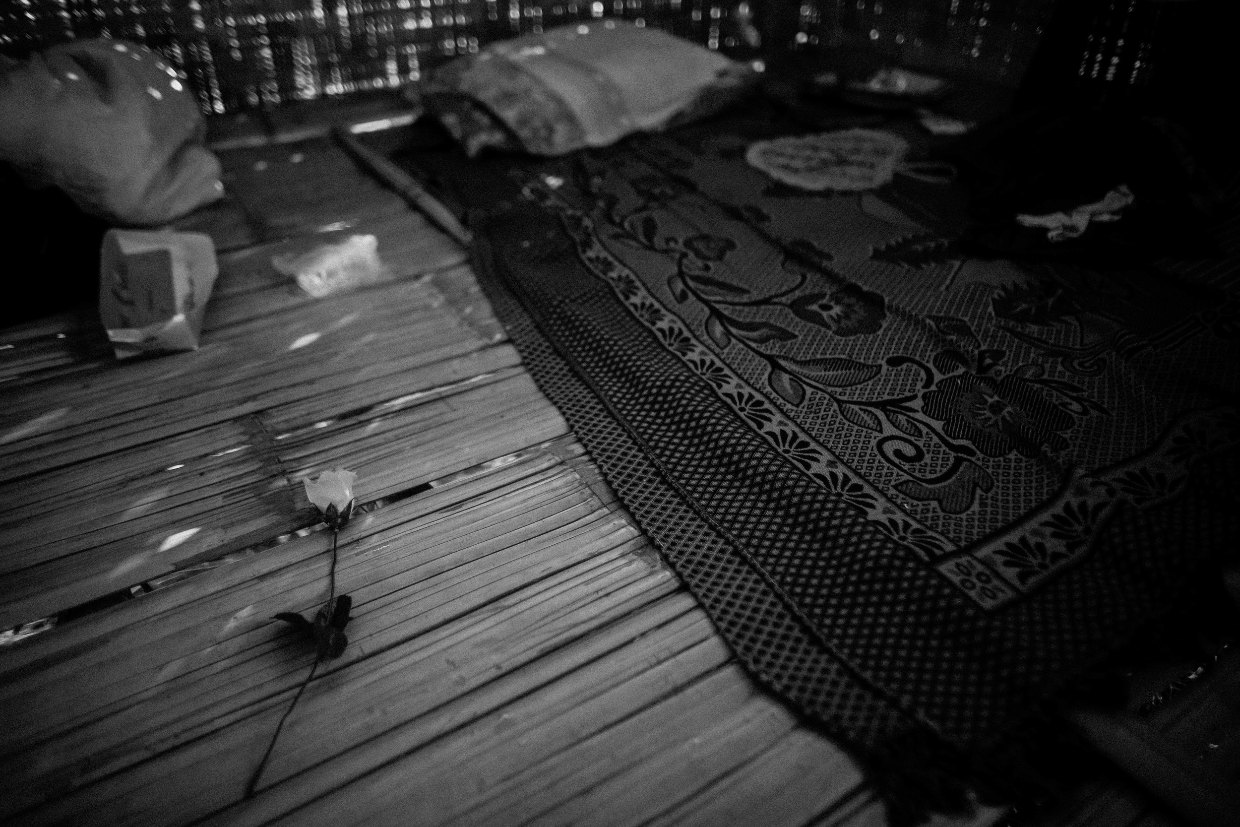 An artificial rose left besides the bed of one of the students at Aung Mintha. Roses were given to the students after a choir performance in the village.
