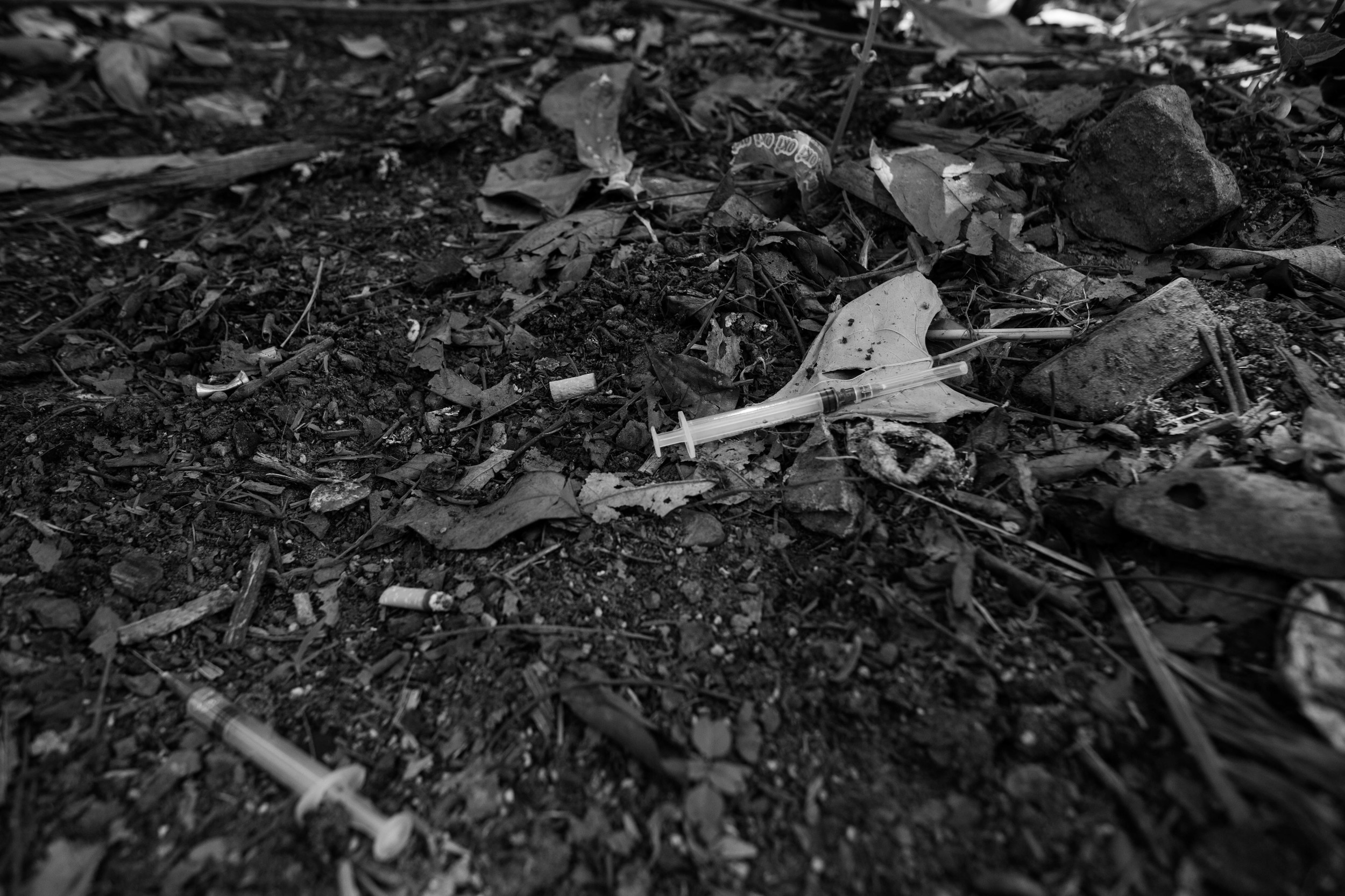 """Used syringes litter an alley in Myitkyina, Myanmar. Locals estimate that, in some villages,about eighty percent of their youth are hooked on heroin. They are calling the addicts, """"The Lost Generation."""""""