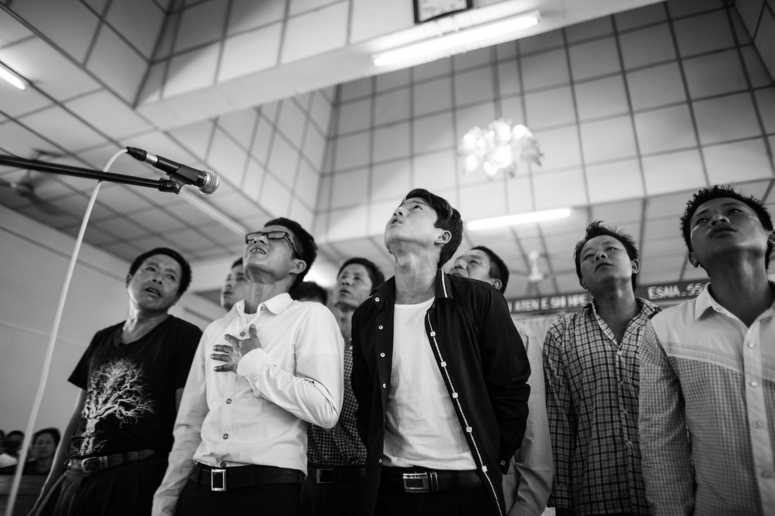 After the first week of confinement, the students at the YCC rehab center are allowed outside the centerand encouraged to attend church in town. Today, they are performing a few songs for the community at church.
