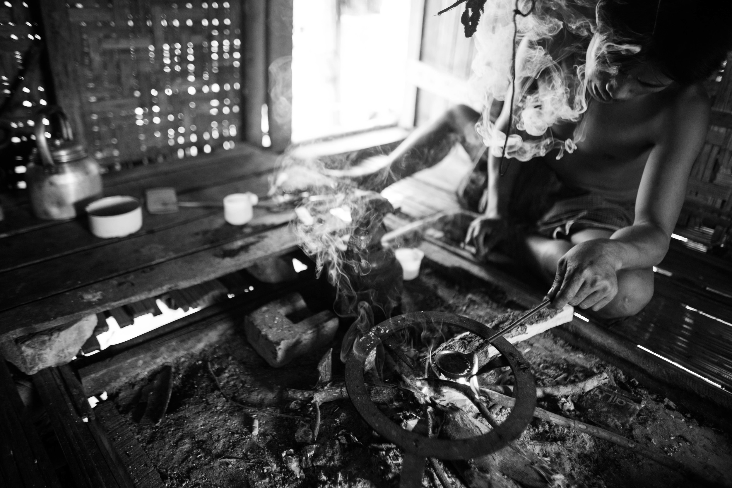 """After four days in the YCC rehab camp, """"Hkun Aung"""" opted out, returned to his village and immediately found black opium to inject and smoke. This village two hours outside of Myitkyinaconsists of about 70 households. Most of the men have an opium habit."""
