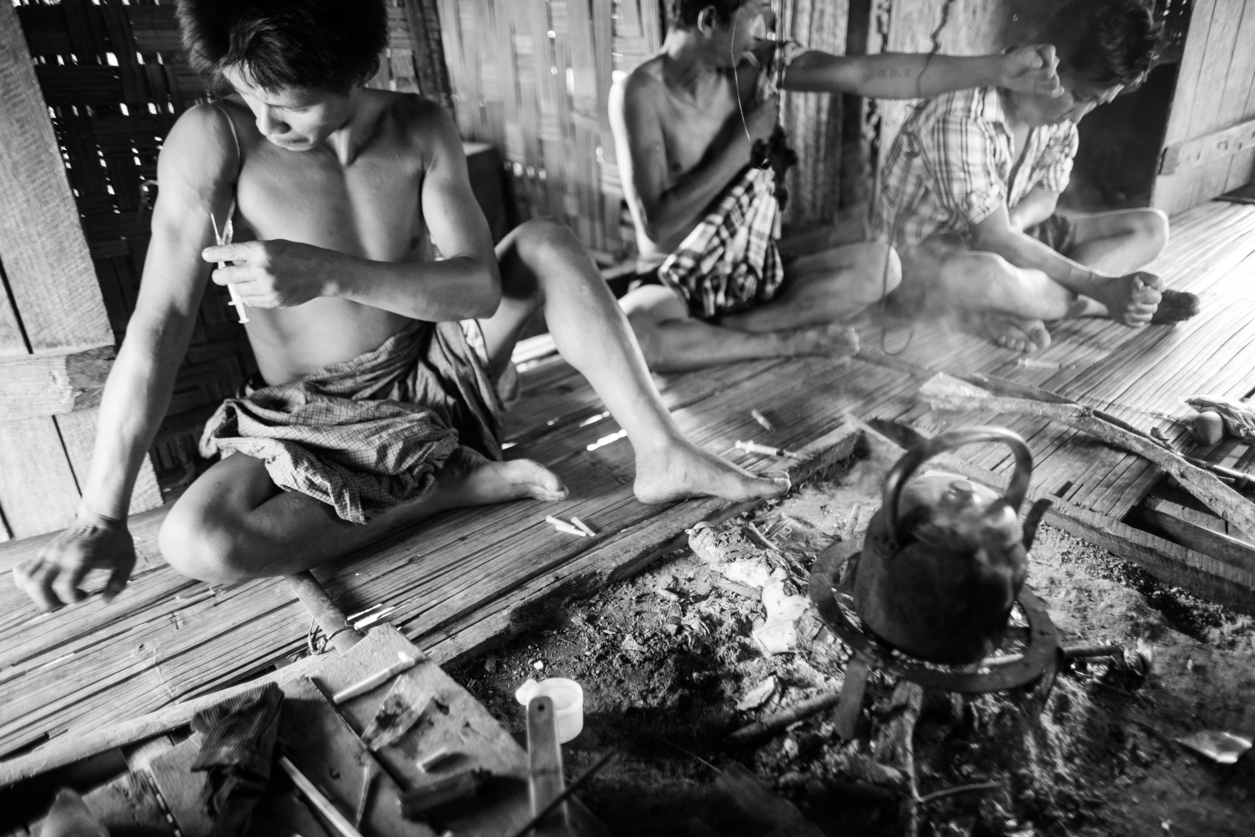"""""""Hkun Aung"""" injects black opium with is friends in his village."""