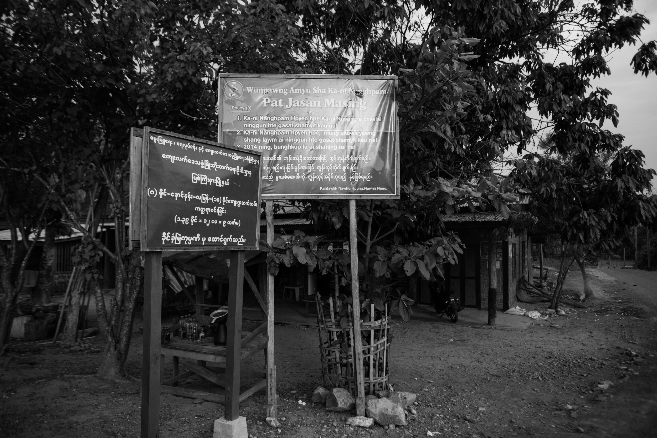 Signs like these popped up around Myanmar's northern city of Myitkyina and surrounding villages last year. They announce a mission to wipe out drugs. The Patjasan program is a collaboration between the Kachin Baptist and Catholic church.