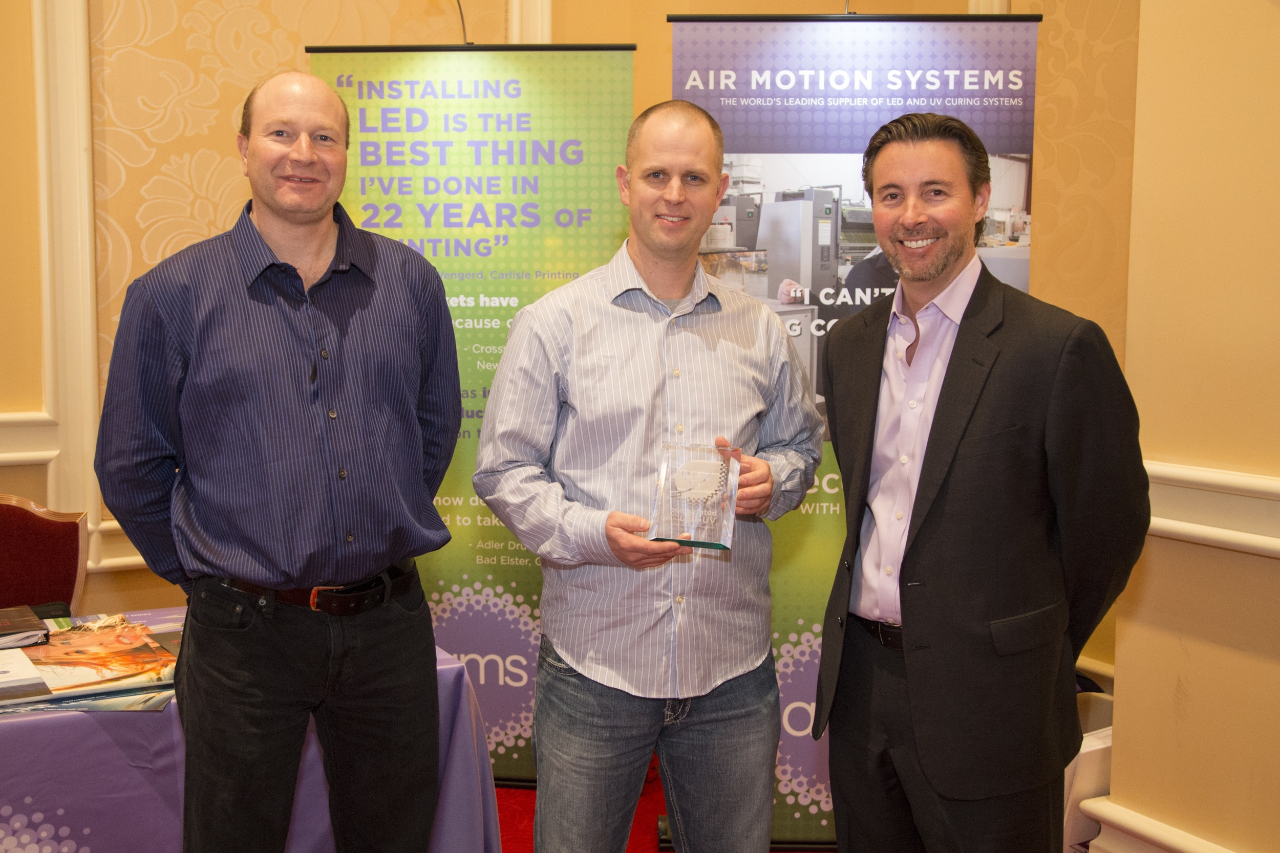 Pictured left to right are Steve Rathert and Jason Thysse of Thysse Printing Service, Inc. and Steve Metcalf of Air Motion Systems, Inc.   AMS
