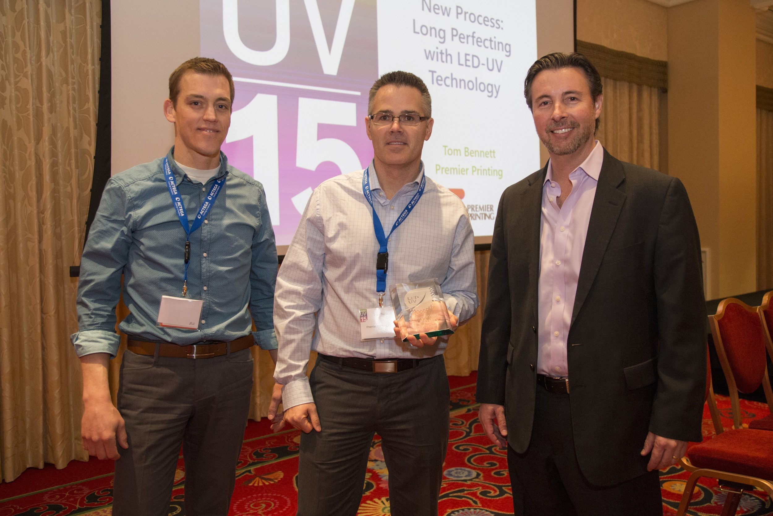 Pictured left to right areDave Gortemaker and Tom Bennett of Premier Printing who received an award for recognition of their leadership in the field of LED printing from Steve Metcalf of AMS on behalf of the International LED UV Association. The award was presented at the PRINT UV 2015 conference held on March 3-4 in Las Vegas, at which Premier presented on the topic to over 200 attendees.