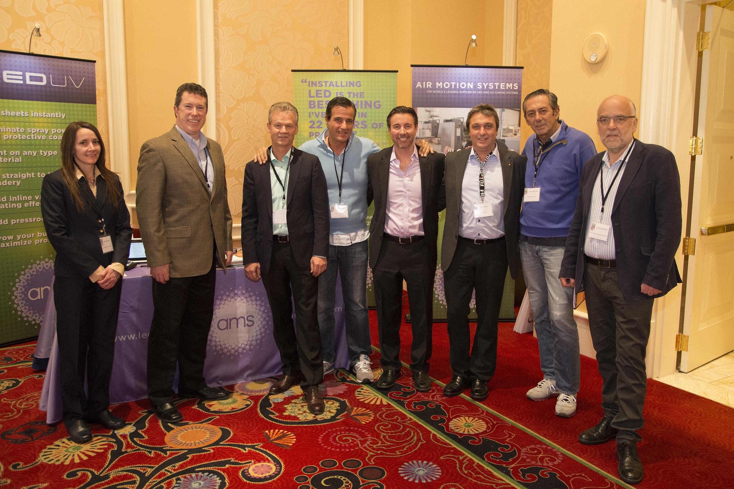 Platinum sponsor Air Motion Systems, Inc. (AMS) showcasing their sponsor table at Print UV 2015.