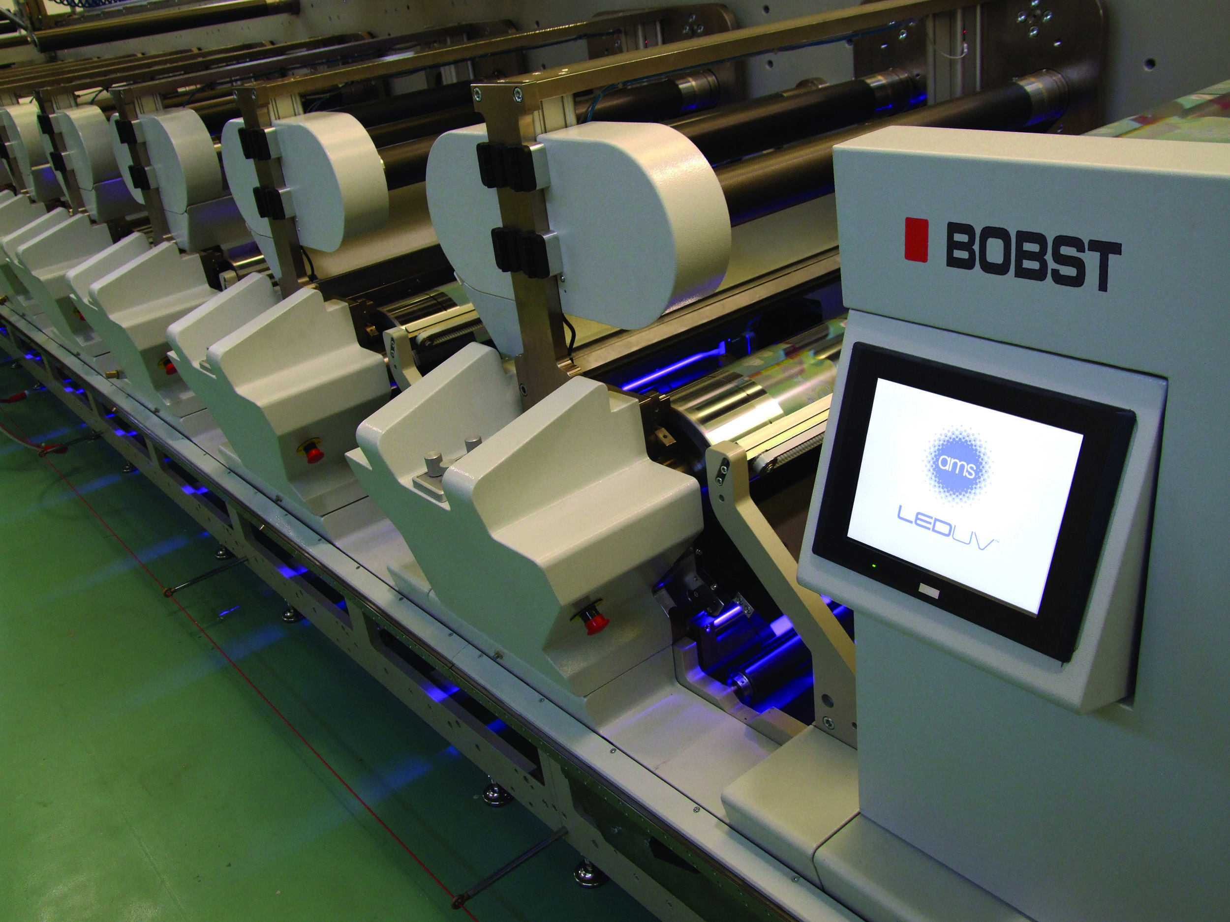 Shown here on a Bobst M5, AMS's LED UV curing system will be installed on a Bobst M6 press and running live onsite at LabelExpo Americas 2016. The trade show is set for the Donald E. Stephens Convention Center in Rosemont, IL, September 13-15.