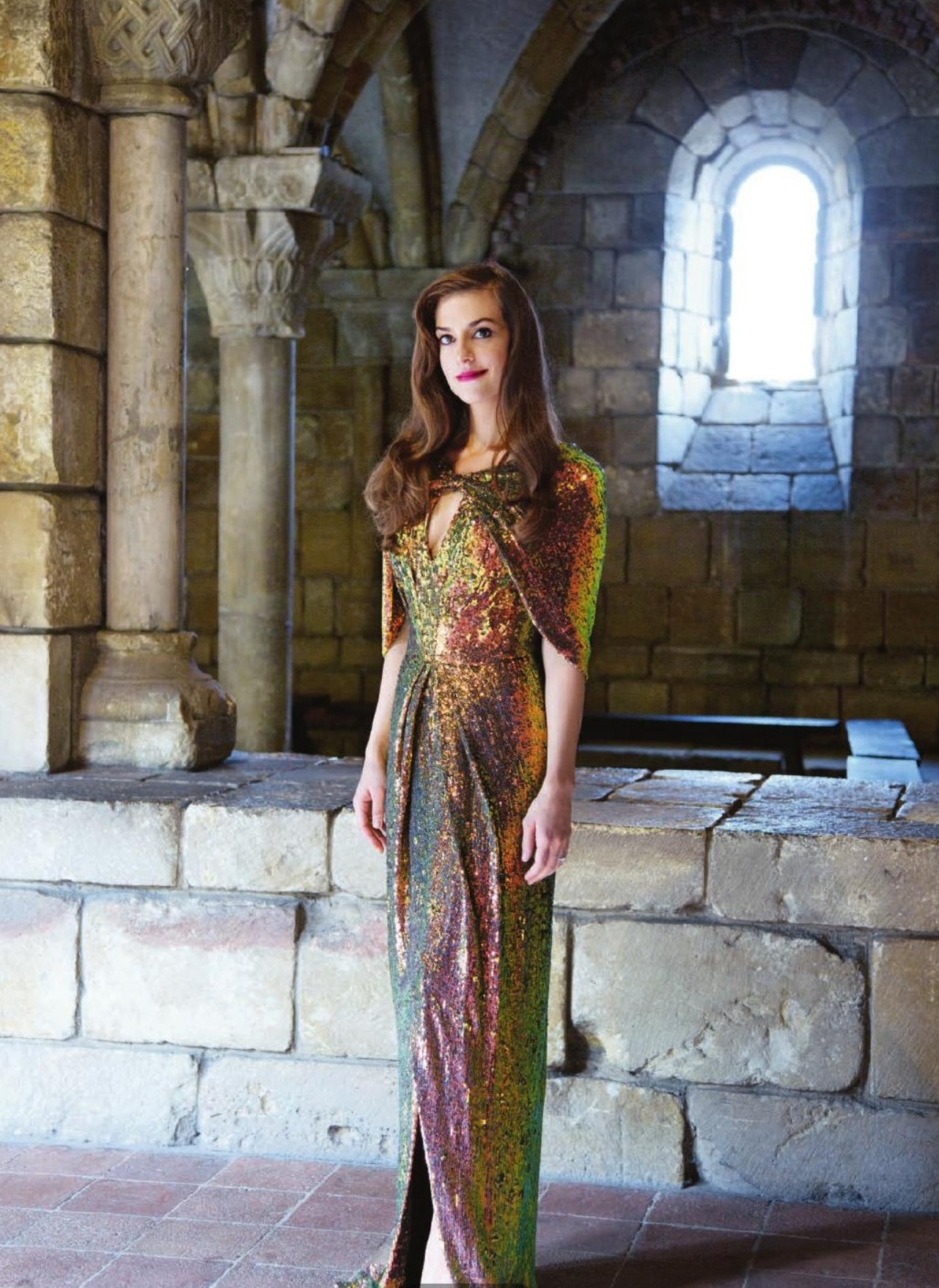 Lorry Newhouse gold sequined dress with cape,  David Webb nail ring and Rupert Sanderson elba suede pumps.