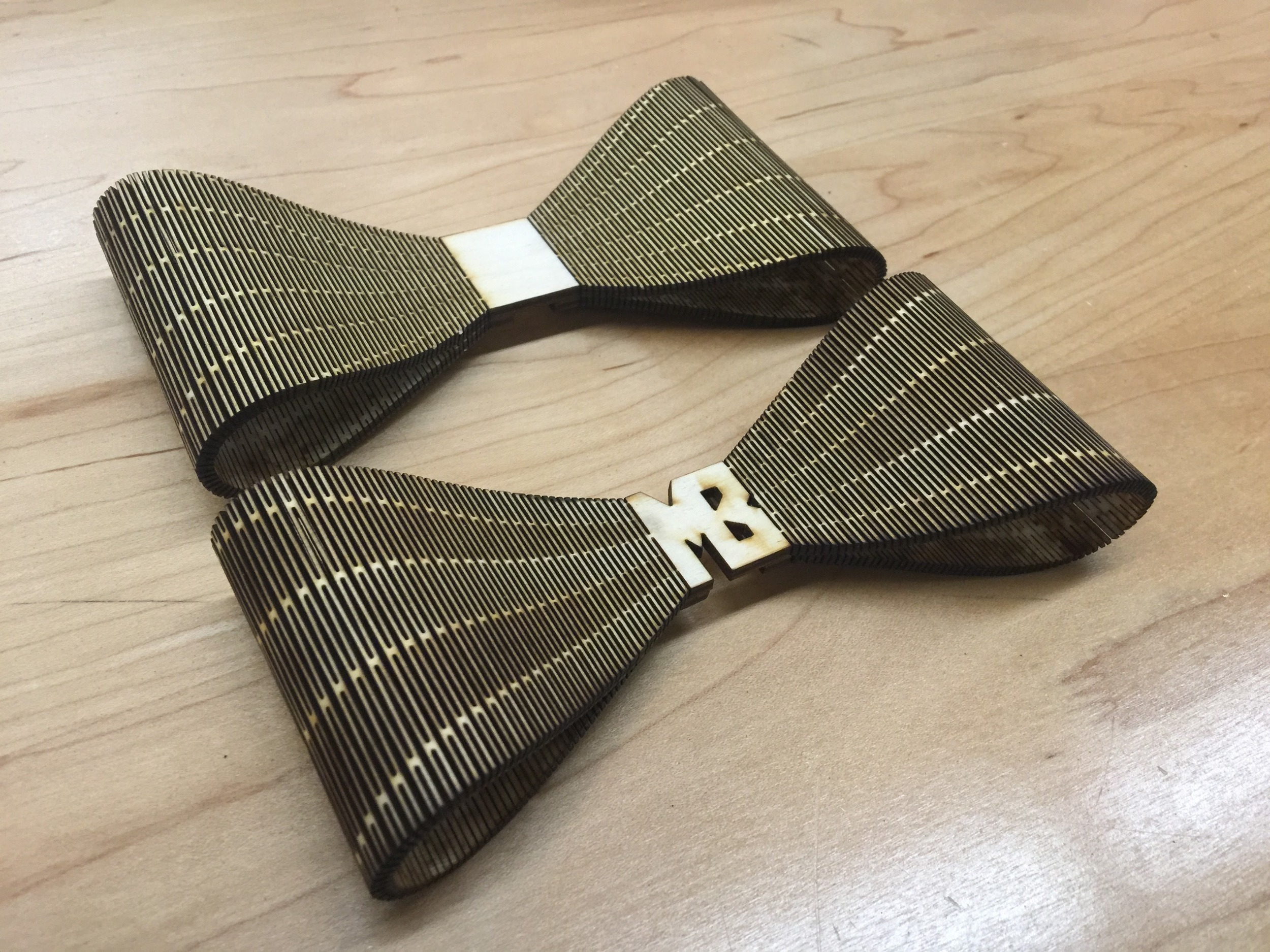 """early prototypes of the """"living hinge"""" wood bow tie design"""