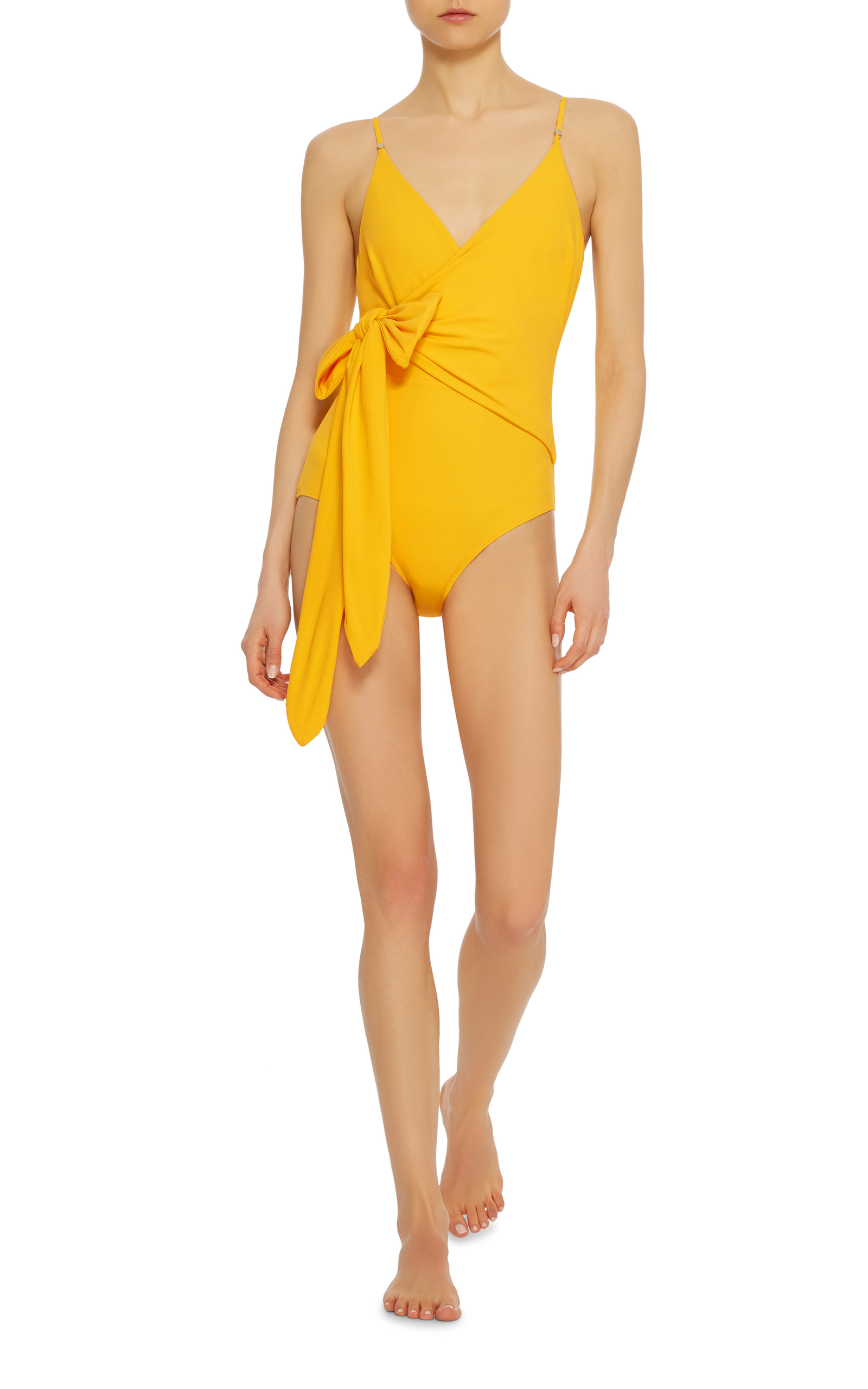 Cool off in this wrap one-piece swimsuit or pair it with high waisted jeans and kitten heels for a chic city look. - Stella McCartney Timeless Wrap One-Piece Suit  modesens.com                                                        $255