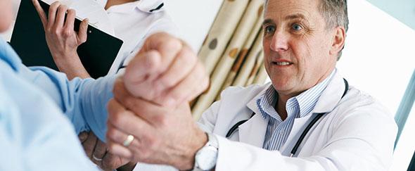 doctor_examining_arm_C.F.-04.03.13.jpg