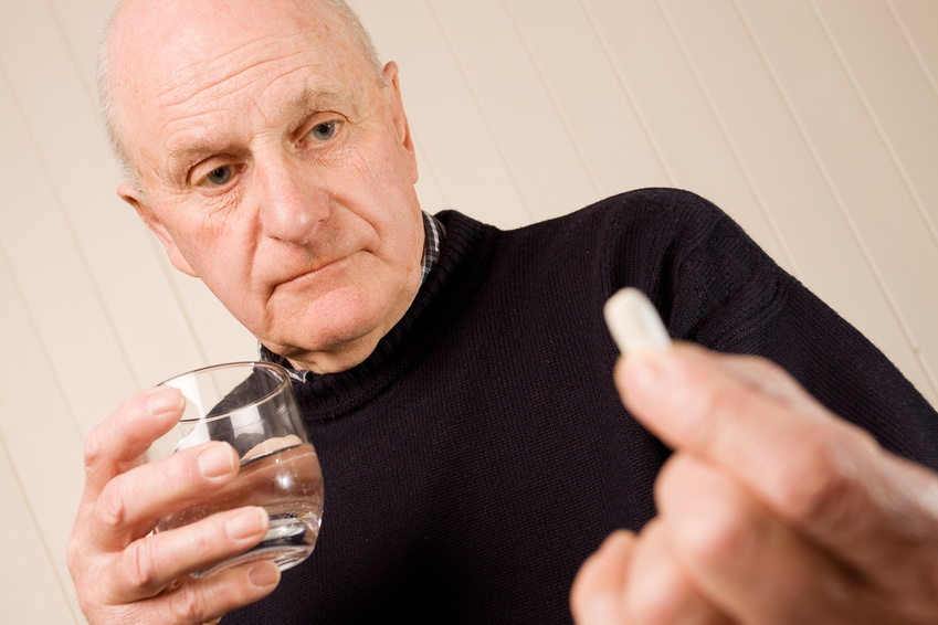 Man taking pain killer_C.F.-05.22.13.jpg