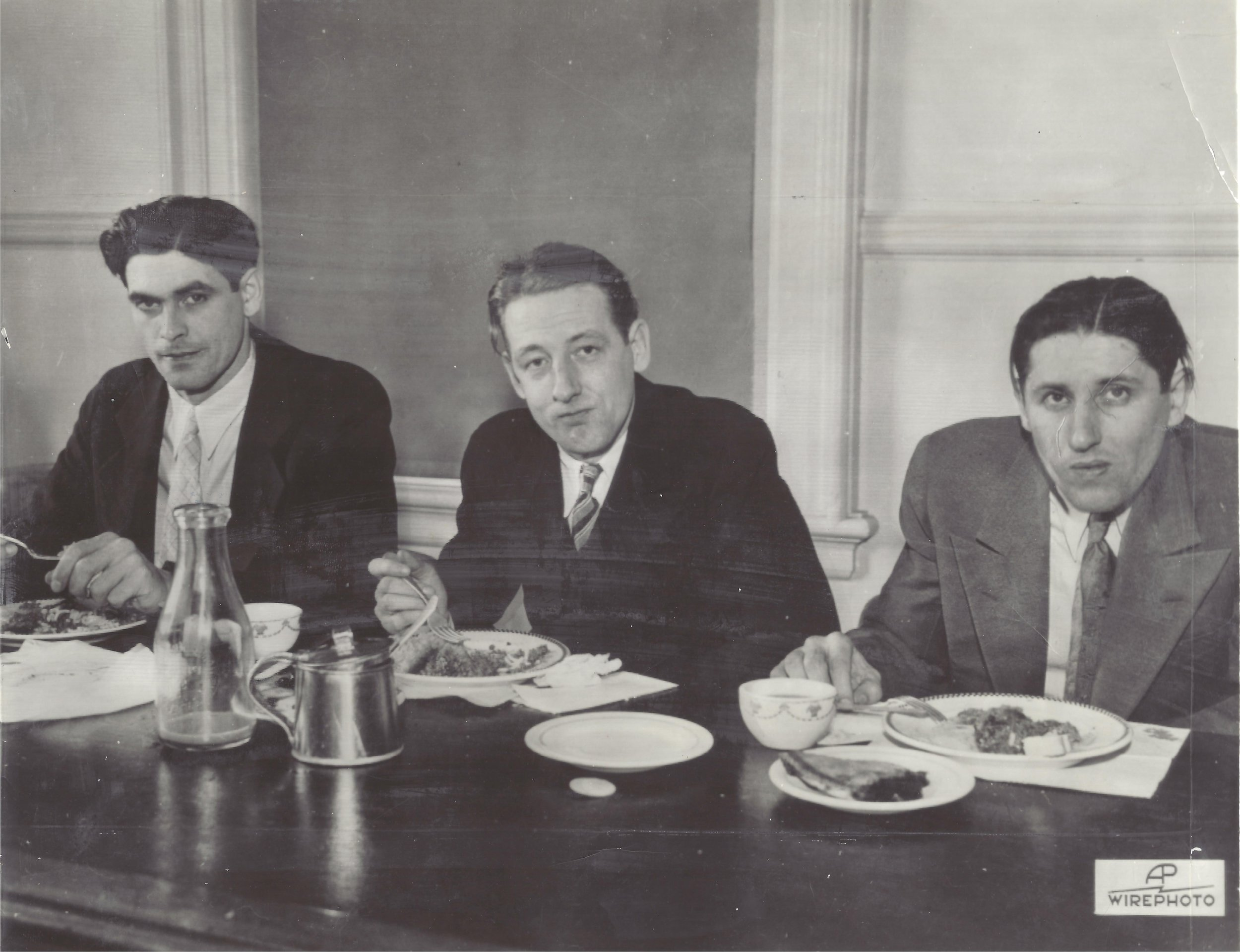 The second photo shows (left to right) convicts Alex McKay, Joe Kristy and Fred Launders eating lunch during a break in their trial.  Landers plead guilty during the trial and the other two were tried under the Lindberg law as they kidnapped a prison guard.