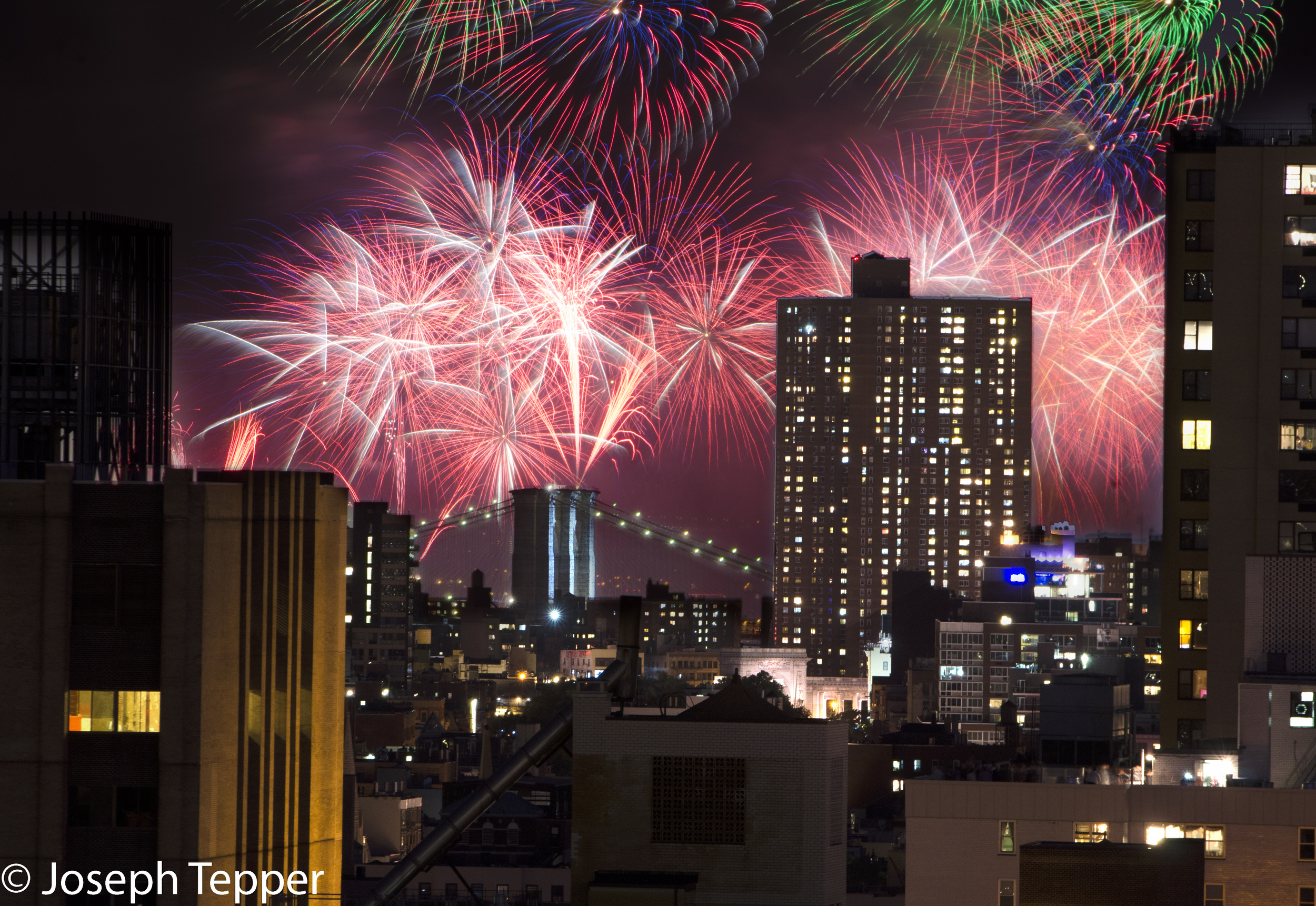 Fireworks soar over the Brooklyn Bridge