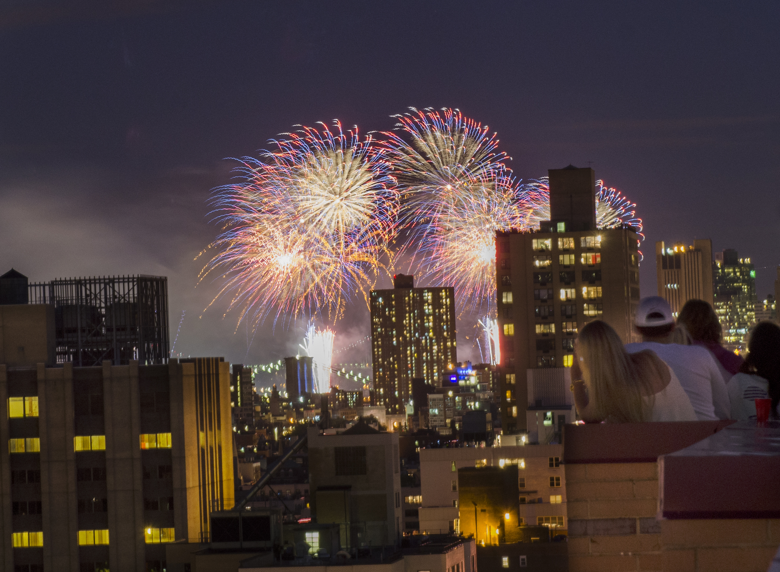 Spectators try to catch a glimpse of the Macy's Fourth of July Fireworks show.