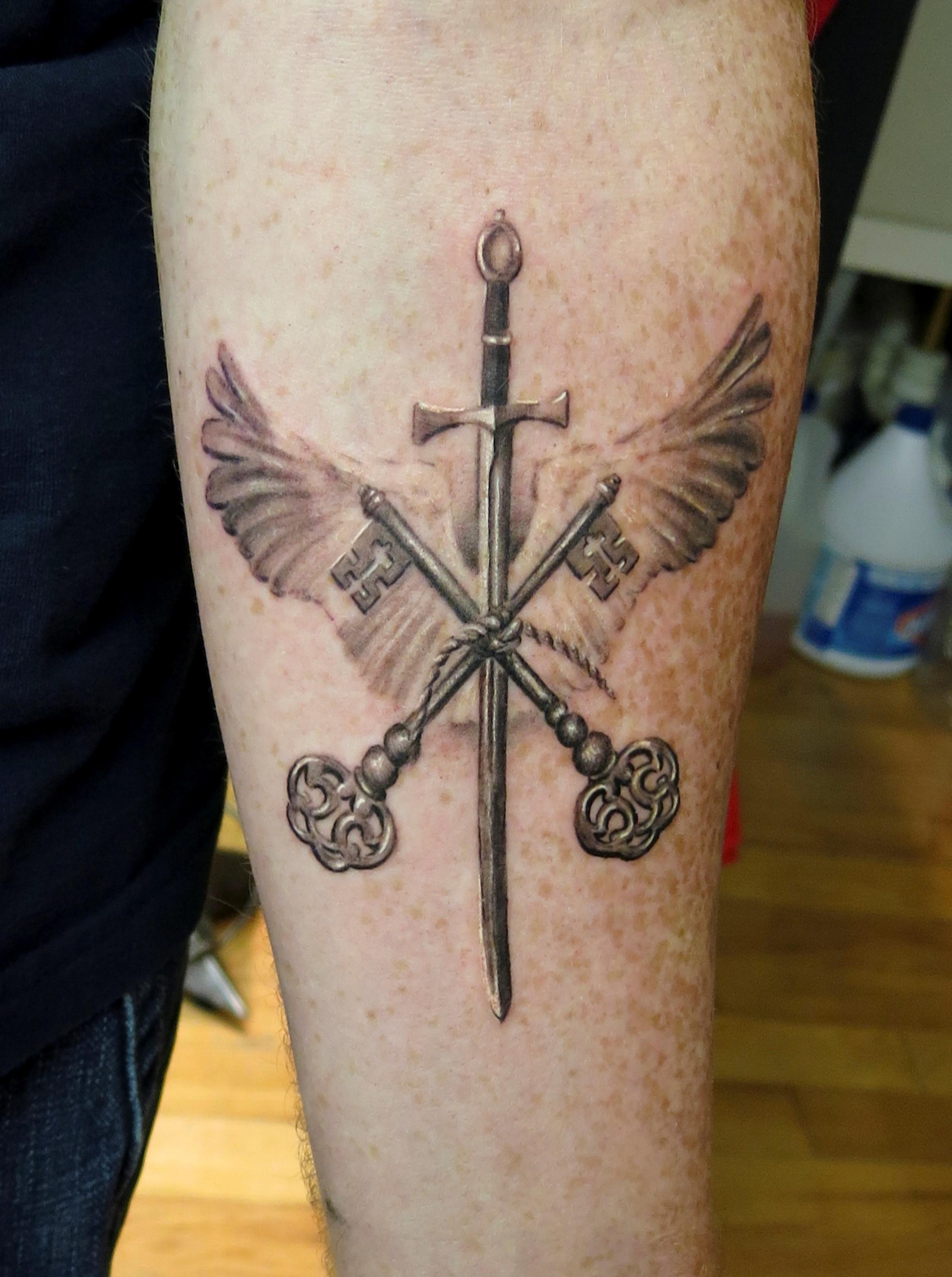 key, sword, wing tattoo