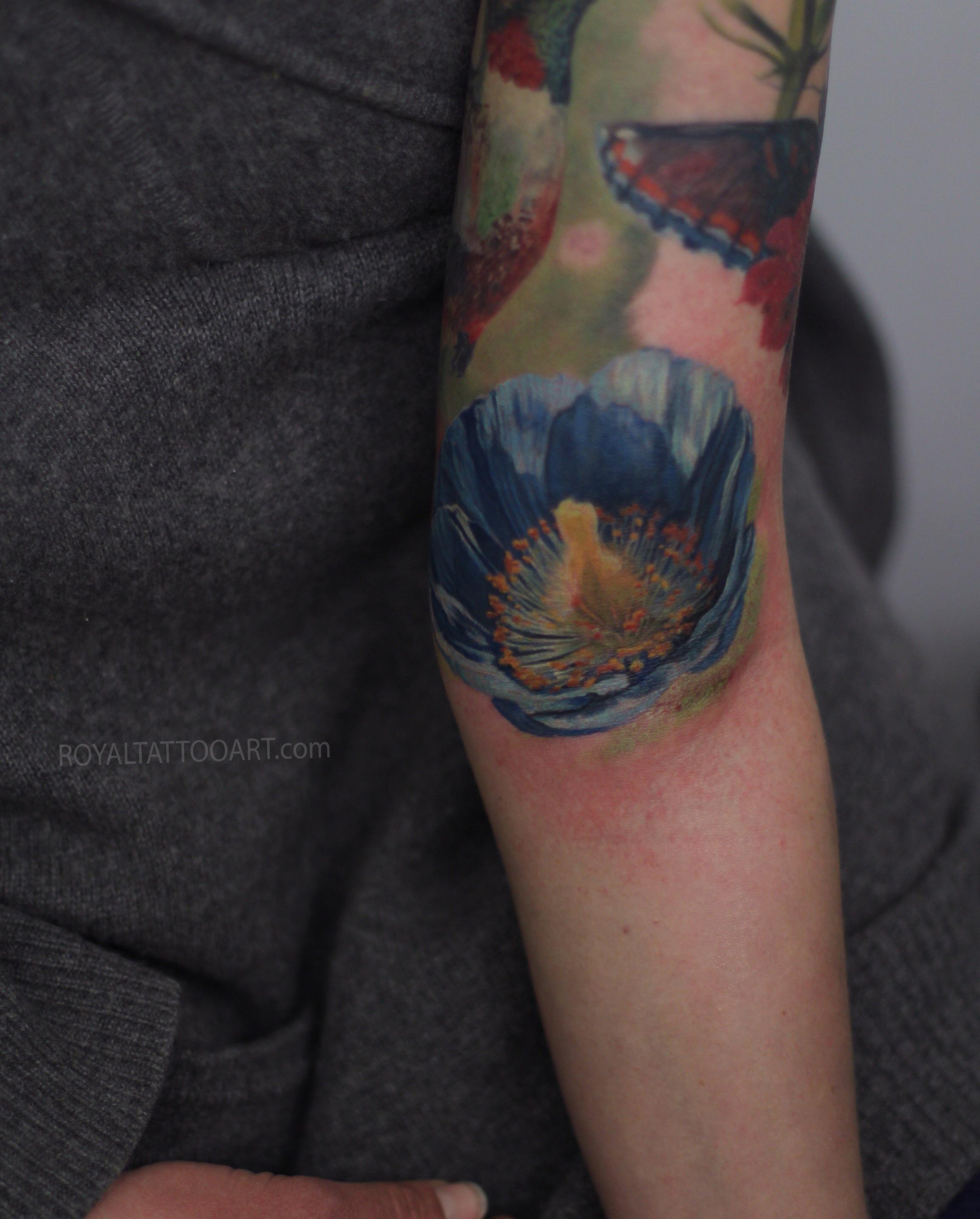 flower detailed arm blue bird.jpg