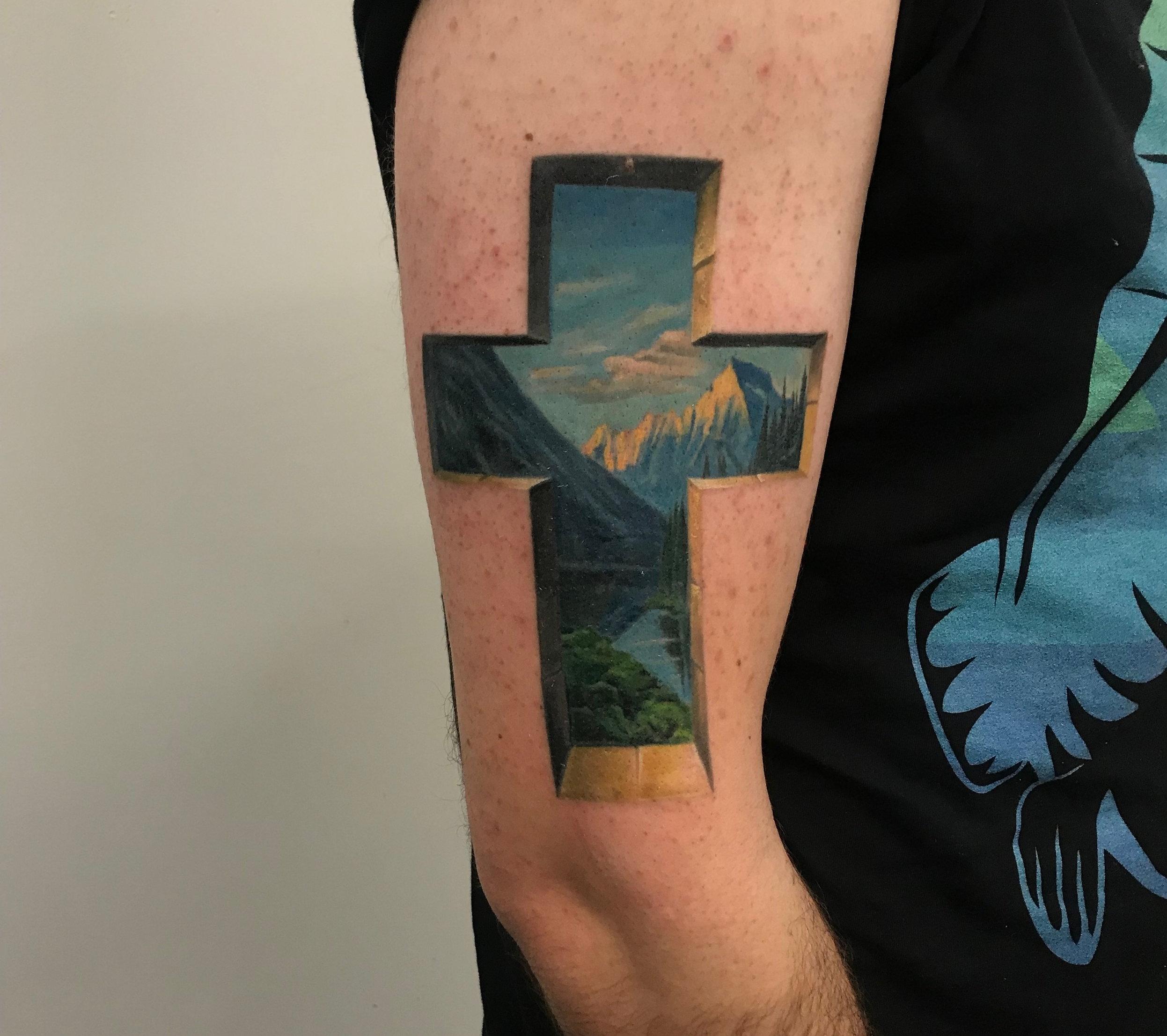 cross landscape 3d tattoo realistic . religion