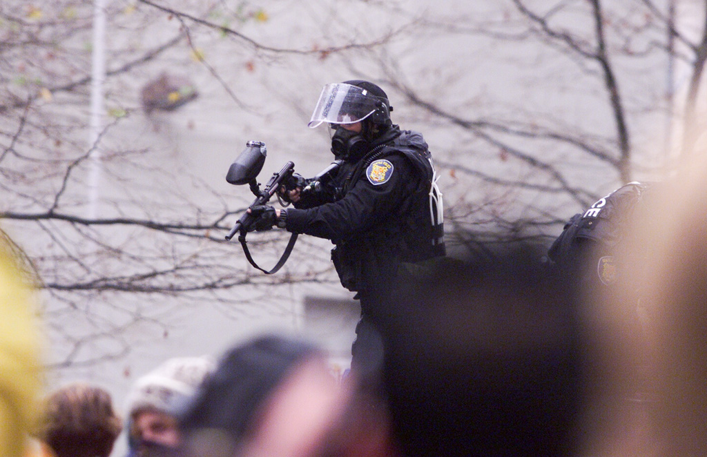 WTO riots, Seattle: policeman fires CS gas weapon
