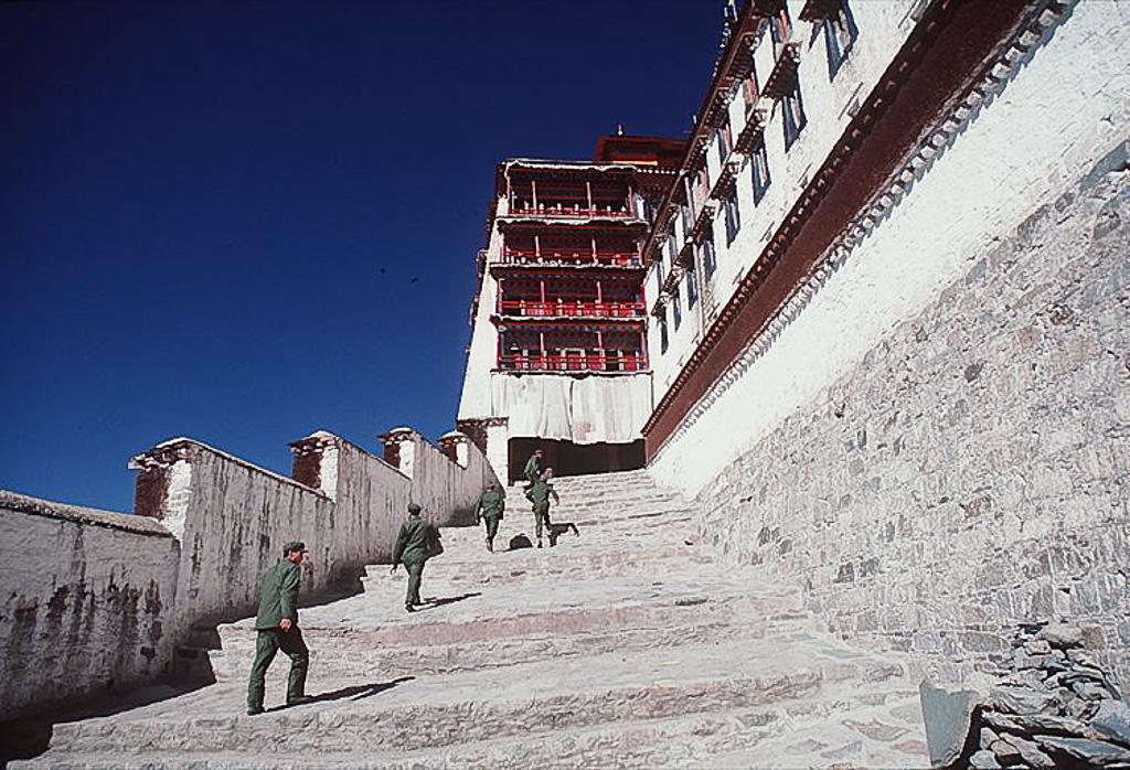 Chinese troops race up the steps of the Potola, Lhasa, Tibet