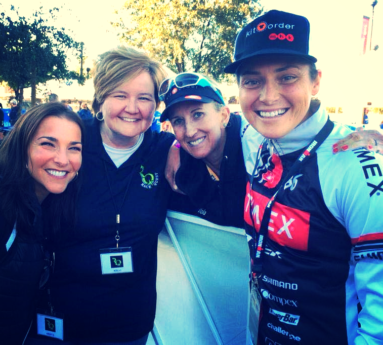 Celebrating victory at the IRONMAN Arizona finish line with RaceQuest Pro Guide,  Meredith Kessler  (center).