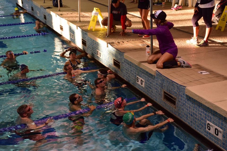 Shad McGaha getting some swim tips from IRONMAN Arizona champion and RQ guide,Meredith Kessler.