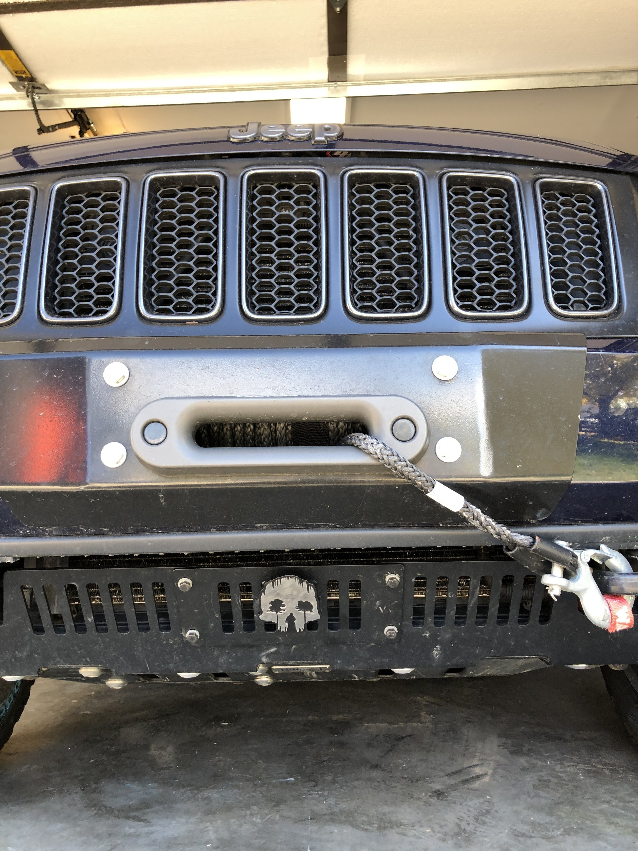 The Chief Products Lower Front Guard with a Triple Aught Design grille badge.  Alsoi shown is the Rocky Road Outfitters hidden winch mount with bumper plate and a Factor 55 fairlead.