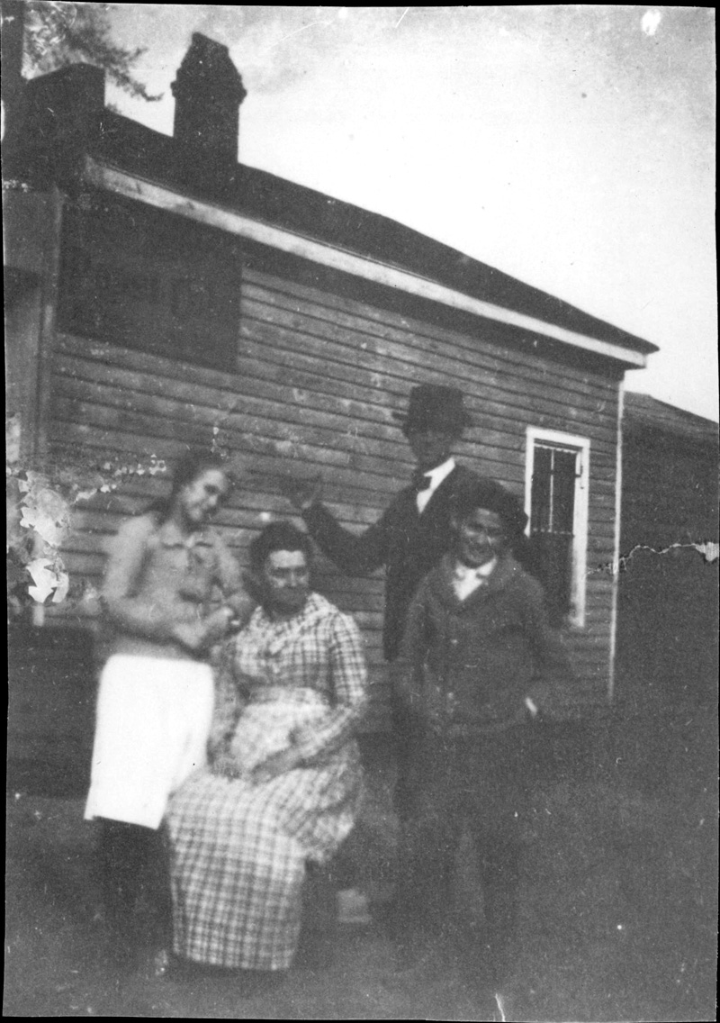 This is the only photo I have of my grandmother (left) with her family. It's not in good shape but it shows the relationship and personality of each.