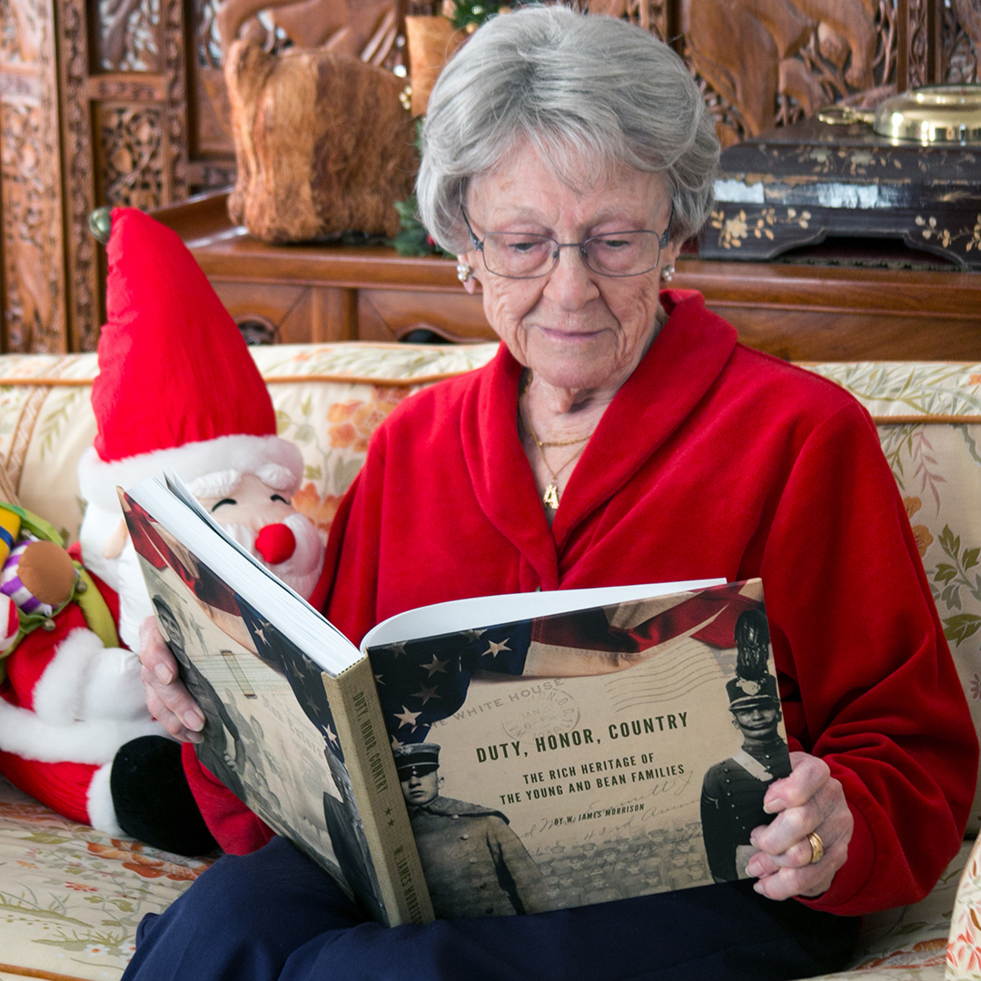 """Bettye today, seeing the finished product for the first time. She is holding the 10"""" square book that was given to family members. We also printed a spectacular oversize coffee-table version at twelve inches square."""