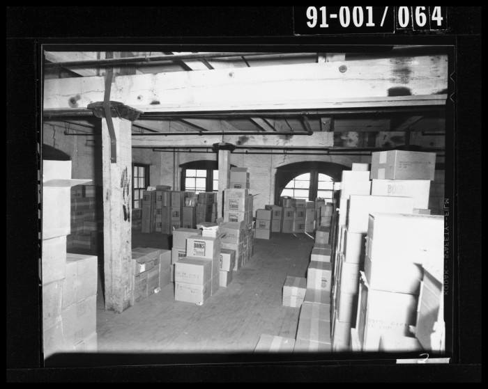Photo 46- Sixth Floor, rows of stacked boxes.jpg
