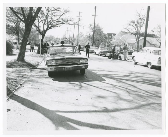 Photo 19- Police, spectators, and witnesses at the crime scene.jpg