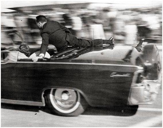 Photo 37- Clint Hill jumping into the President's vehicle.jpg