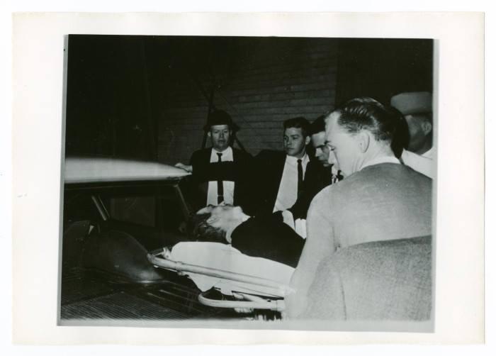Photo 15- Oswald loaded into ambulence.jpg