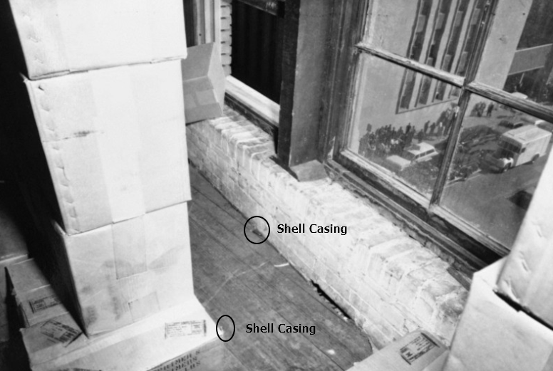 Photo 89- Sixth Floor, Two of three shell casings southeast window.png